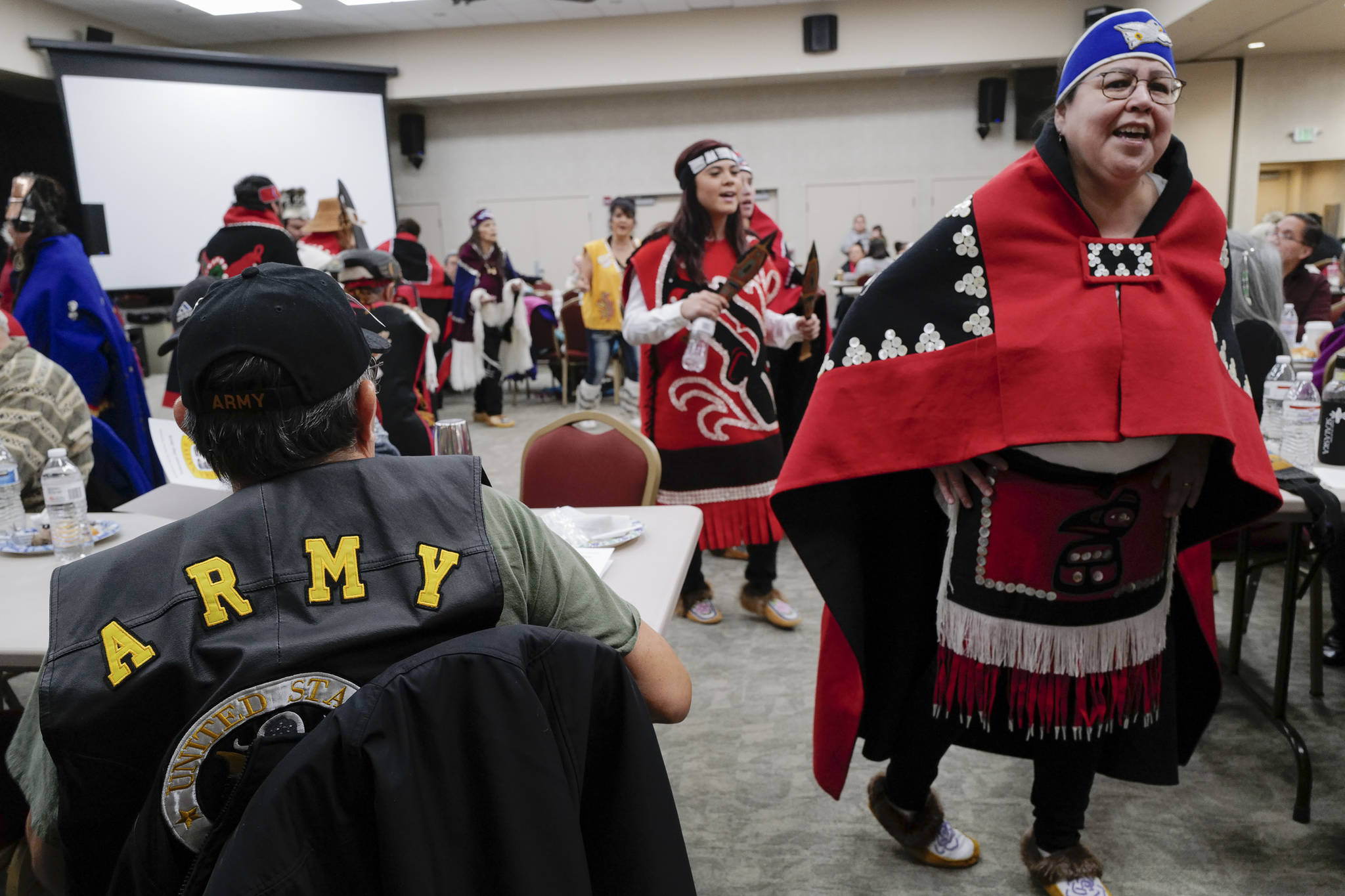 Marlis Mayeda, of the Yaaw Tei Yi Dance Group, right, performs during the Southeast Alaska Native Veteran's Veterans Day luncheon at the Elizabeth Peratrovich Hall on Monday, Nov. 11, 2019. (Michael Penn | Juneau Empire)