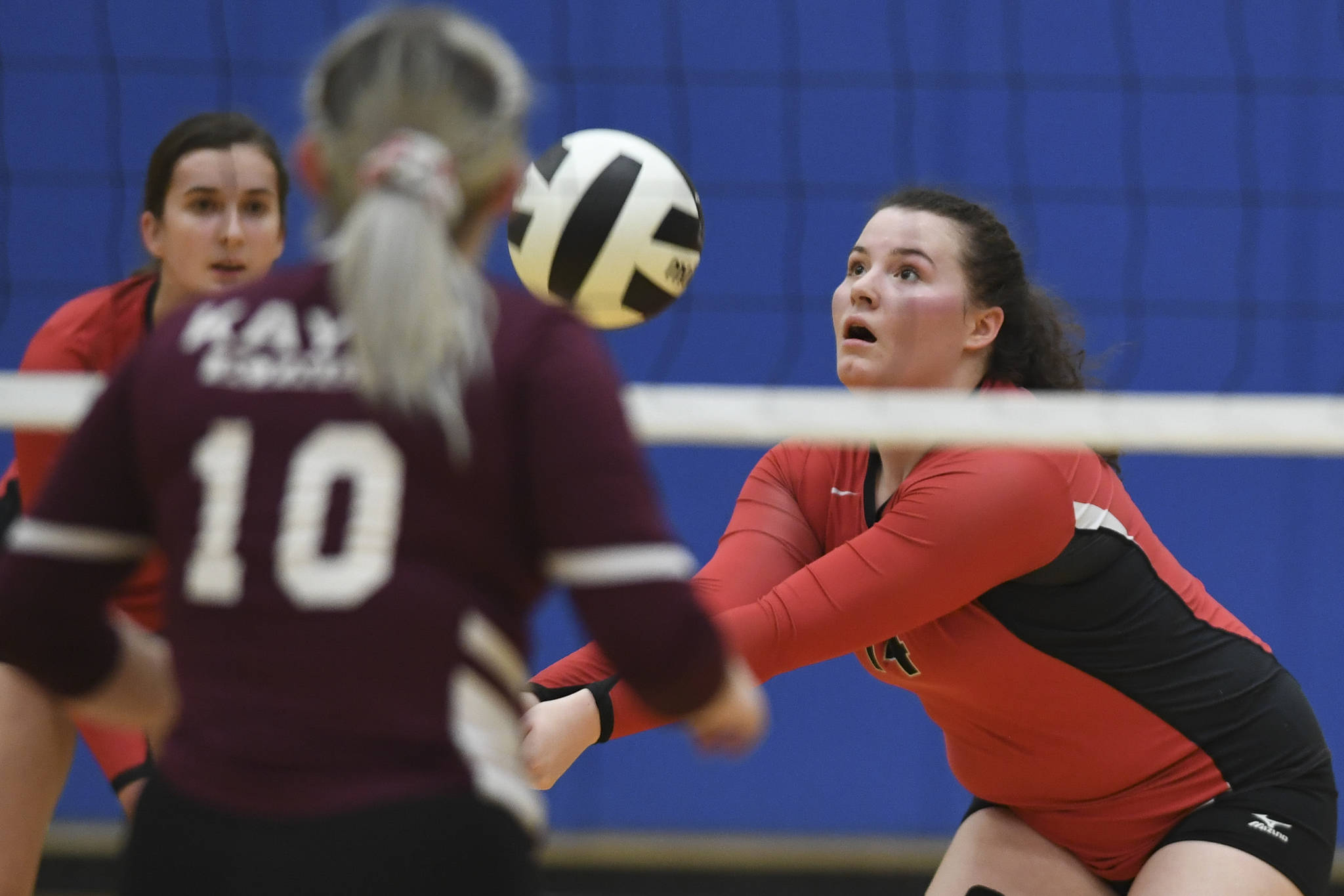 Juneau-Douglas' Gabi Griggs bumps the ball up against Ketchikan during the Region V Volleyball Tournament at Thunder Mountain High School on Thursday, Nov. 7, 2019. (Michael Penn | Juneau Empire File)