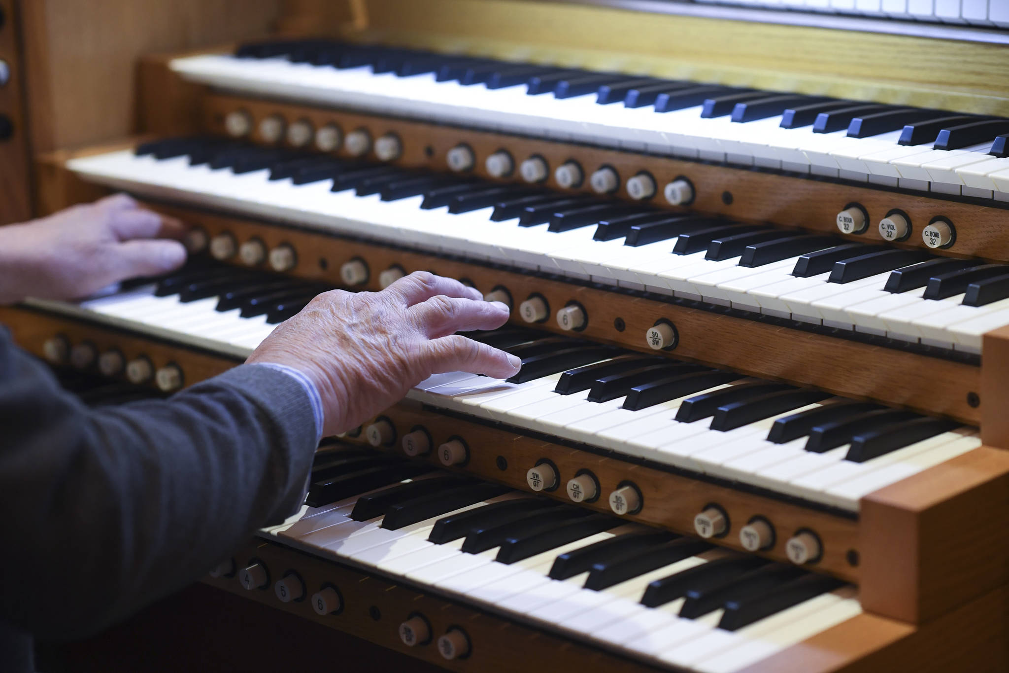 Jonas Nordwall, organist and artistic director of music for the First United Methodist Church in Portland, Oregon, works on Thursday, Nov. 14, 2019, at preparing a 2013 Allen Bravura Organ for its first public concert at Holy Trinity Episcopal Church. Nordwall played free inaugural concert at the church on Friday, Nov. 15. (Michael Penn | Juneau Empire)