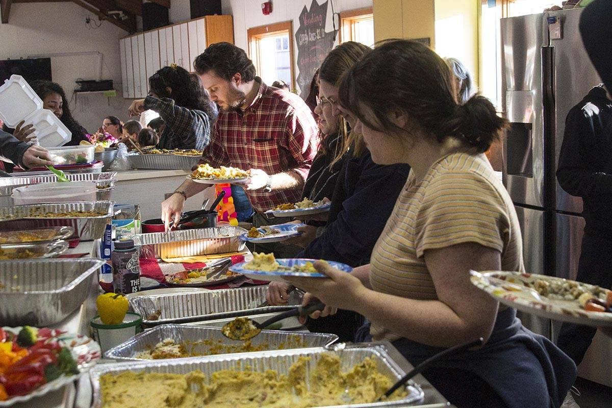 Volunteers came together to cook and serve a Thanksgiving meal for Yaakoosge Daakahidi High School students at the Zach Gordon Youth Center on Nov. 27, 2019 following a crash that killed two YDHS students last week. (Michael S. Lockett)