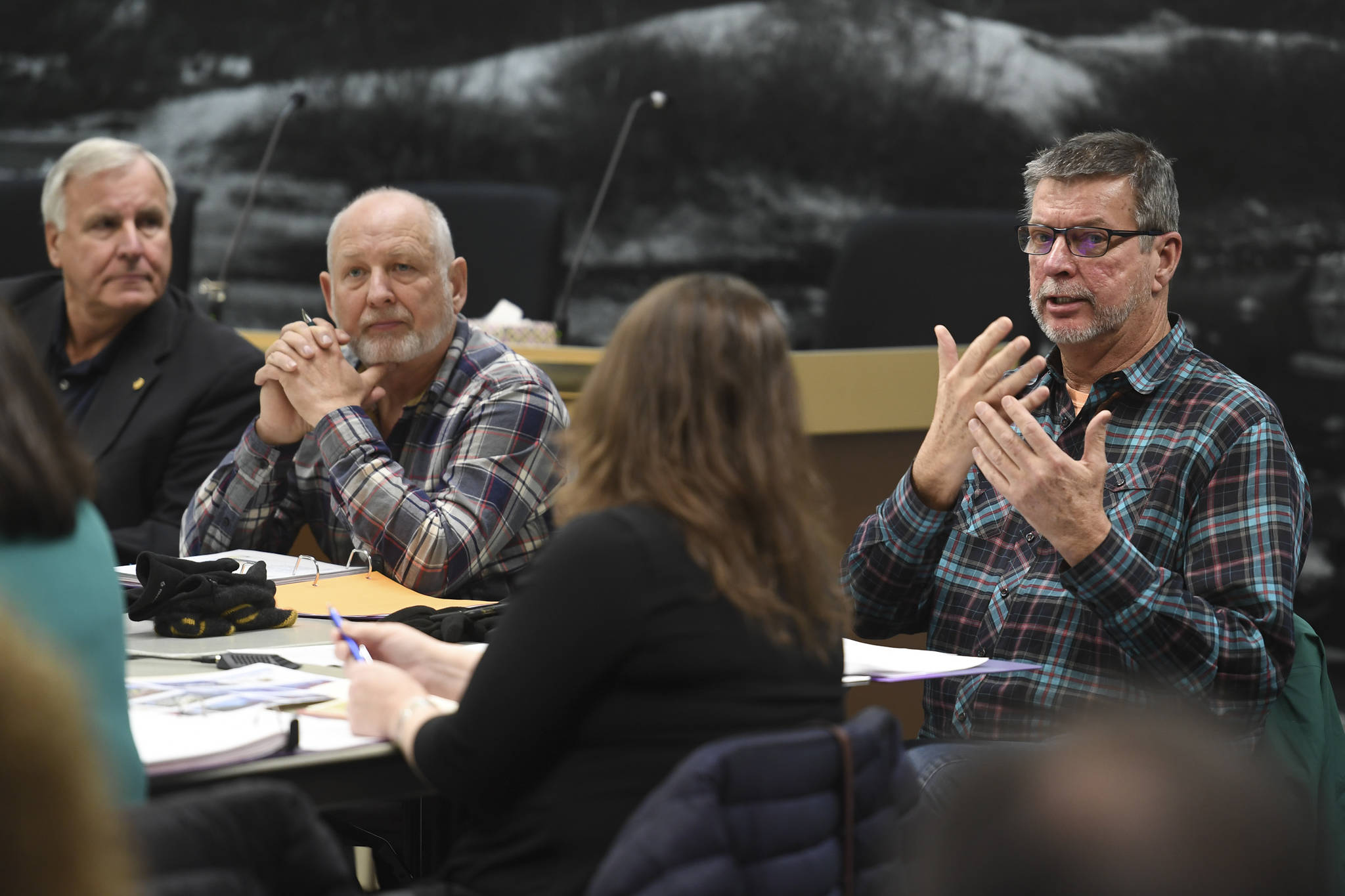 Kirby Day, Juneau's Tourism Best Management Practices coordinator and operations manager for Holland America Group, speaks during the Tourism Industry Task Force in the Assembly chambers on Tuesday, Dec. 3, 2019. (Michael Penn | Juneau Empire)