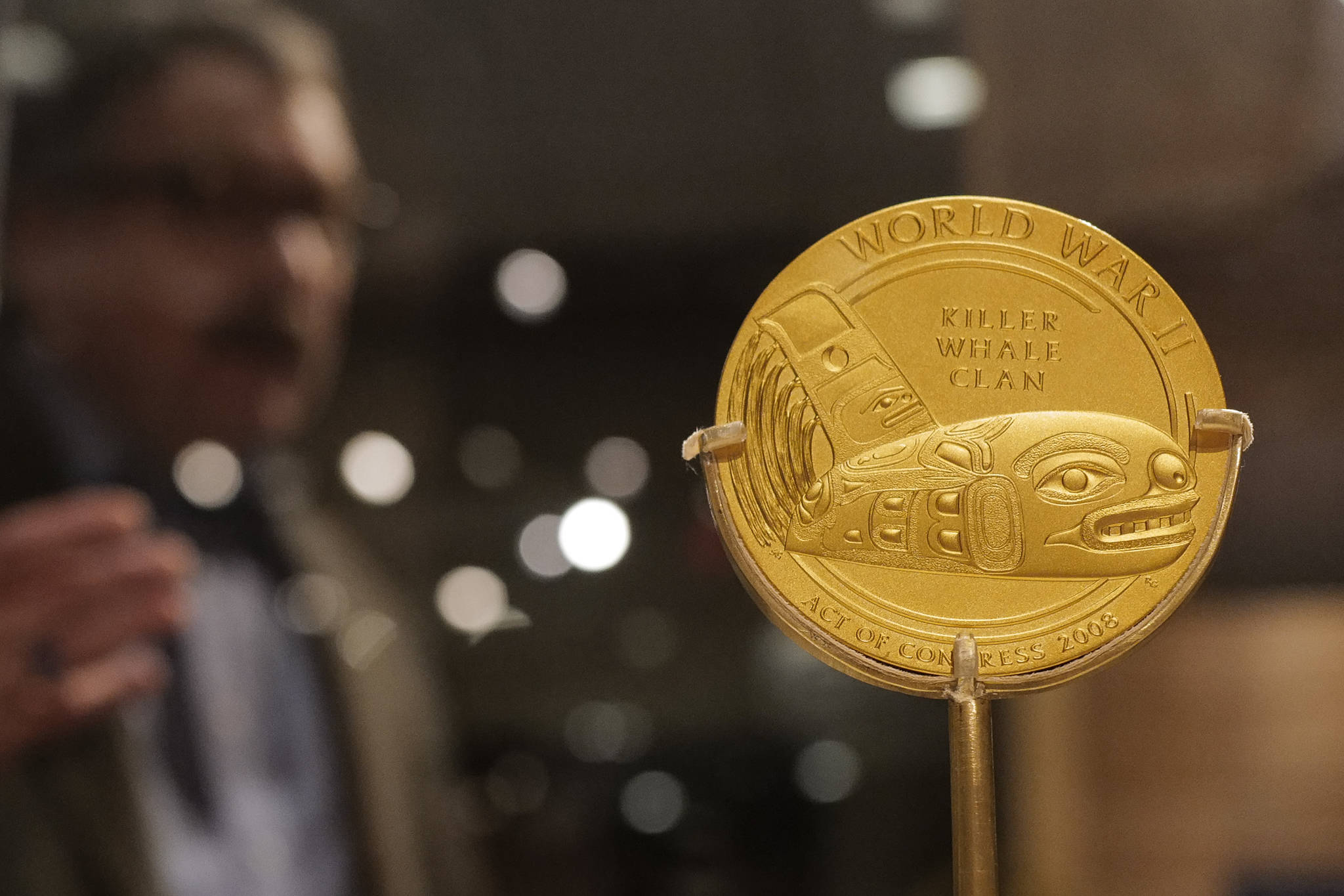 "Chuck Smythe, Ph.D., History and Culture Director for Sealaska Heritage Institute, gives a tour on Friday, Dec. 6, 2019, of a new exhibit, ""War & Peace"" that includes a Congressional Gold Medal presented to the Dakl'aweidi (Killer Whale Clan) of Angoon in recognition of Tlingit speakers who served in World War II. (Michael Penn 