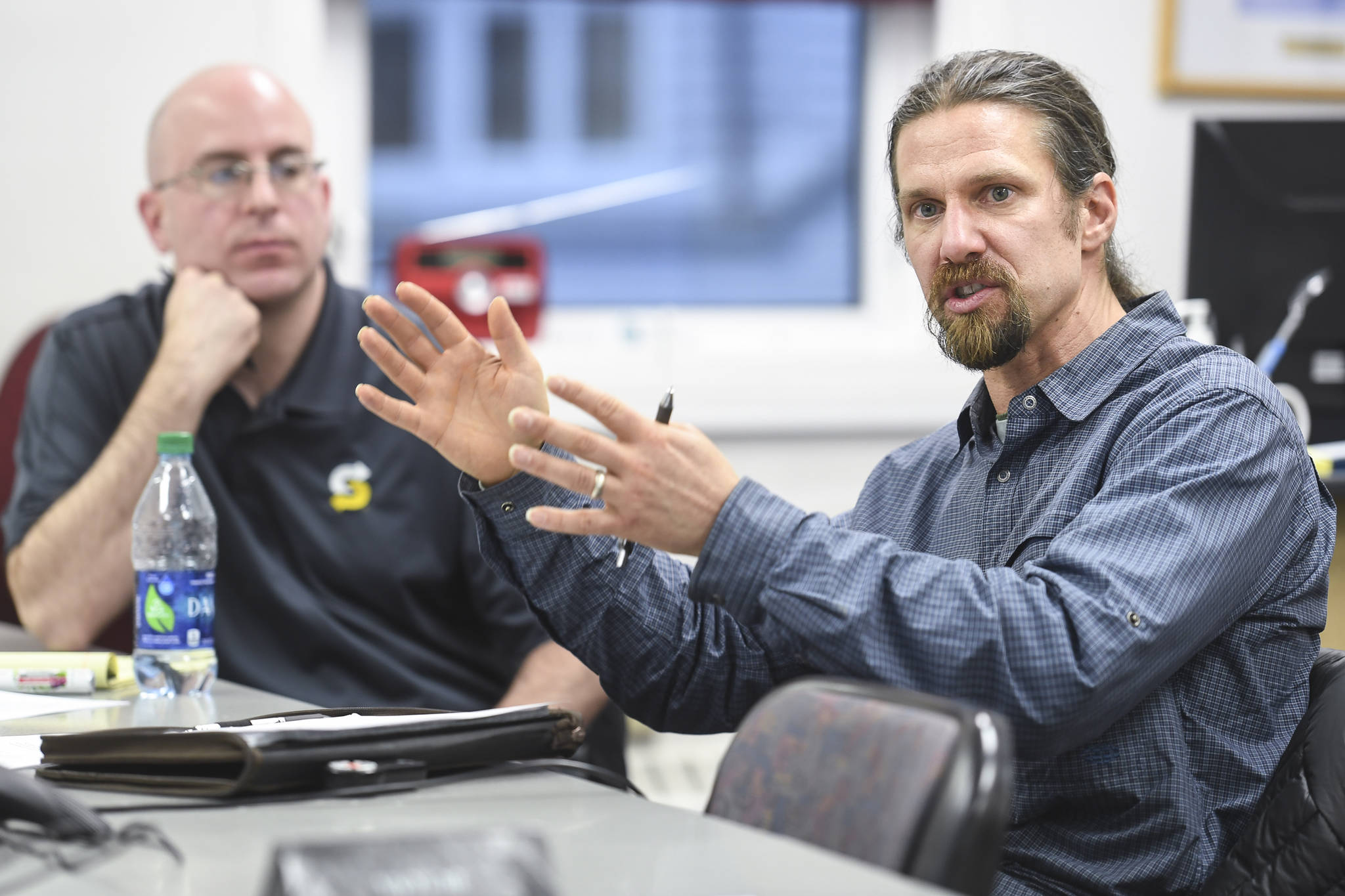 Eaglecrest Ski Area General Manager Dave Scanlan, right, speaks during a task force meeting at City Hall looking into summer activities at the city-owned ski resort on Thursday, Dec. 19, 2019. (Michael Penn | Juneau Empire)