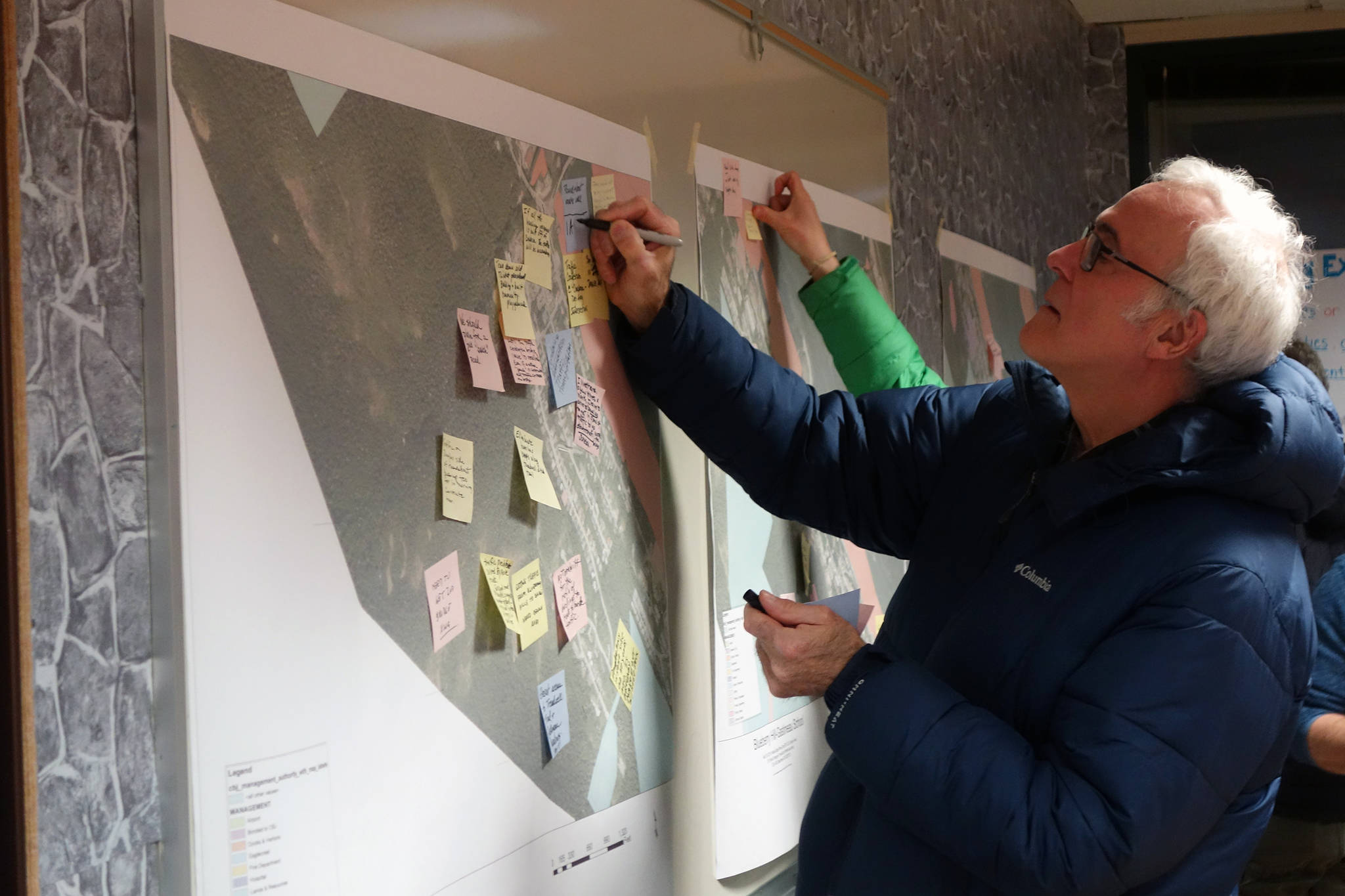Ben Hohenstatt | Juneau Empire                                  Kevin Ritchie adds a comment to a map at a kickoff meeting for City and Borough of Juneau's effort to create South Douglas-West Juneau Area Plan on Wednesday.