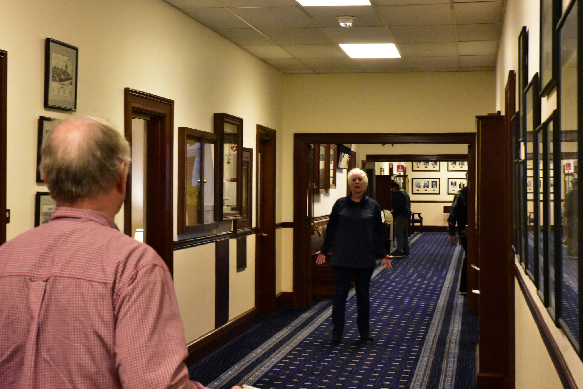 Rep. Louise Stutes, R-Kodiak, chats in the hallway of the Alaska State Capitol on Monday. (Peter Segall | Juneau Empire)