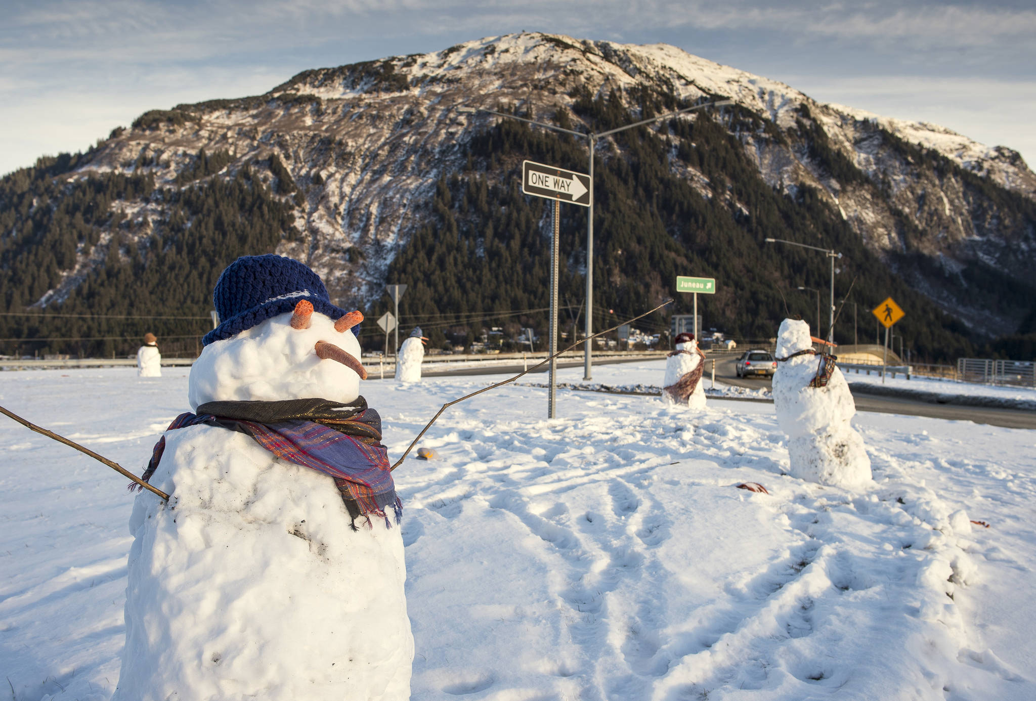 Snowmen that showed up in the Douglas roundabout. (Michael Penn | Juneau Empire File)