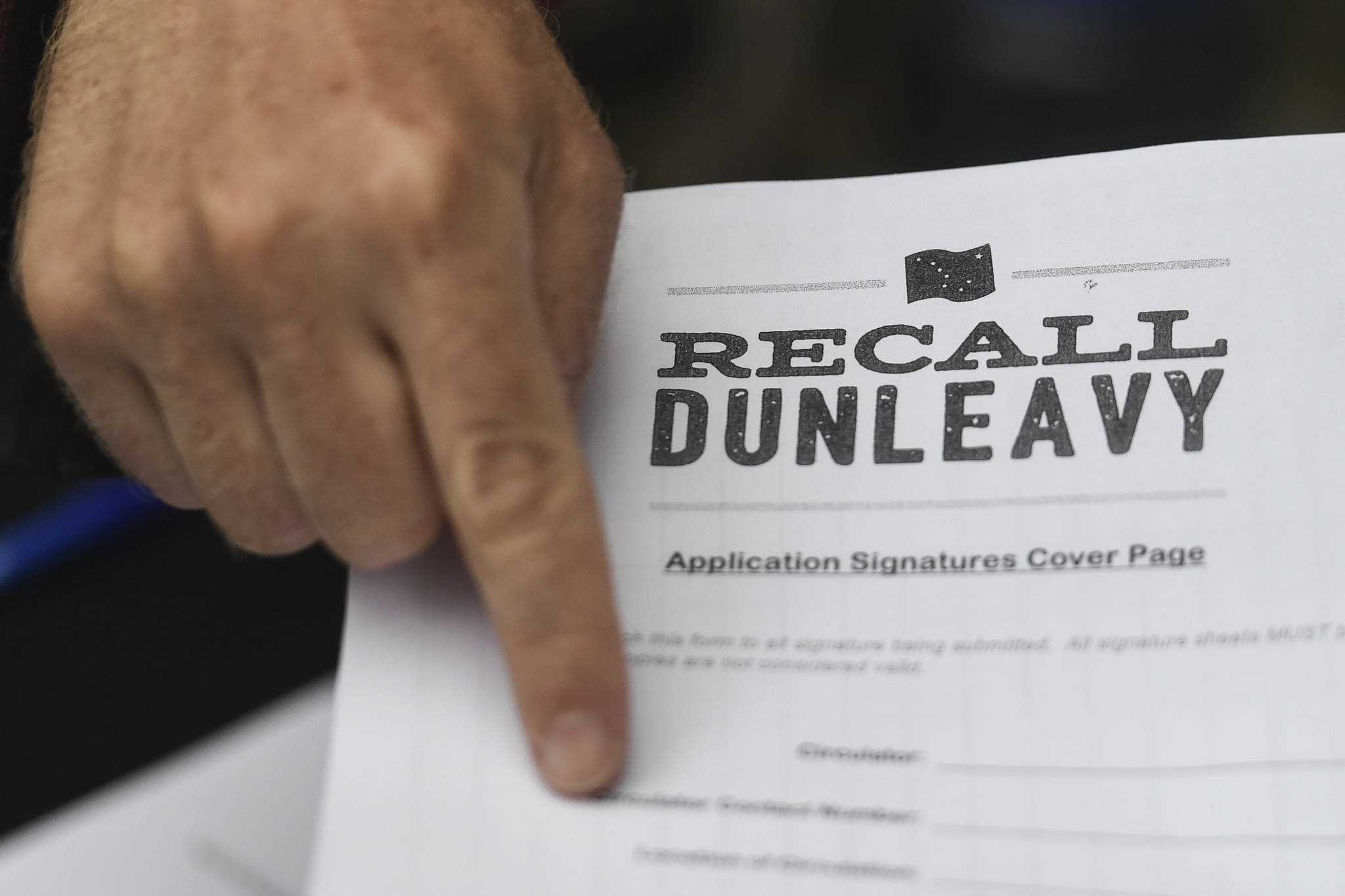Juneau residents line up outside of the Planet Alaska Gallery to sign an application petition to recall Gov. Mike Dunleavy on Thursday, Aug. 1, 2019. (Michael Penn | Juneau Empire File)
