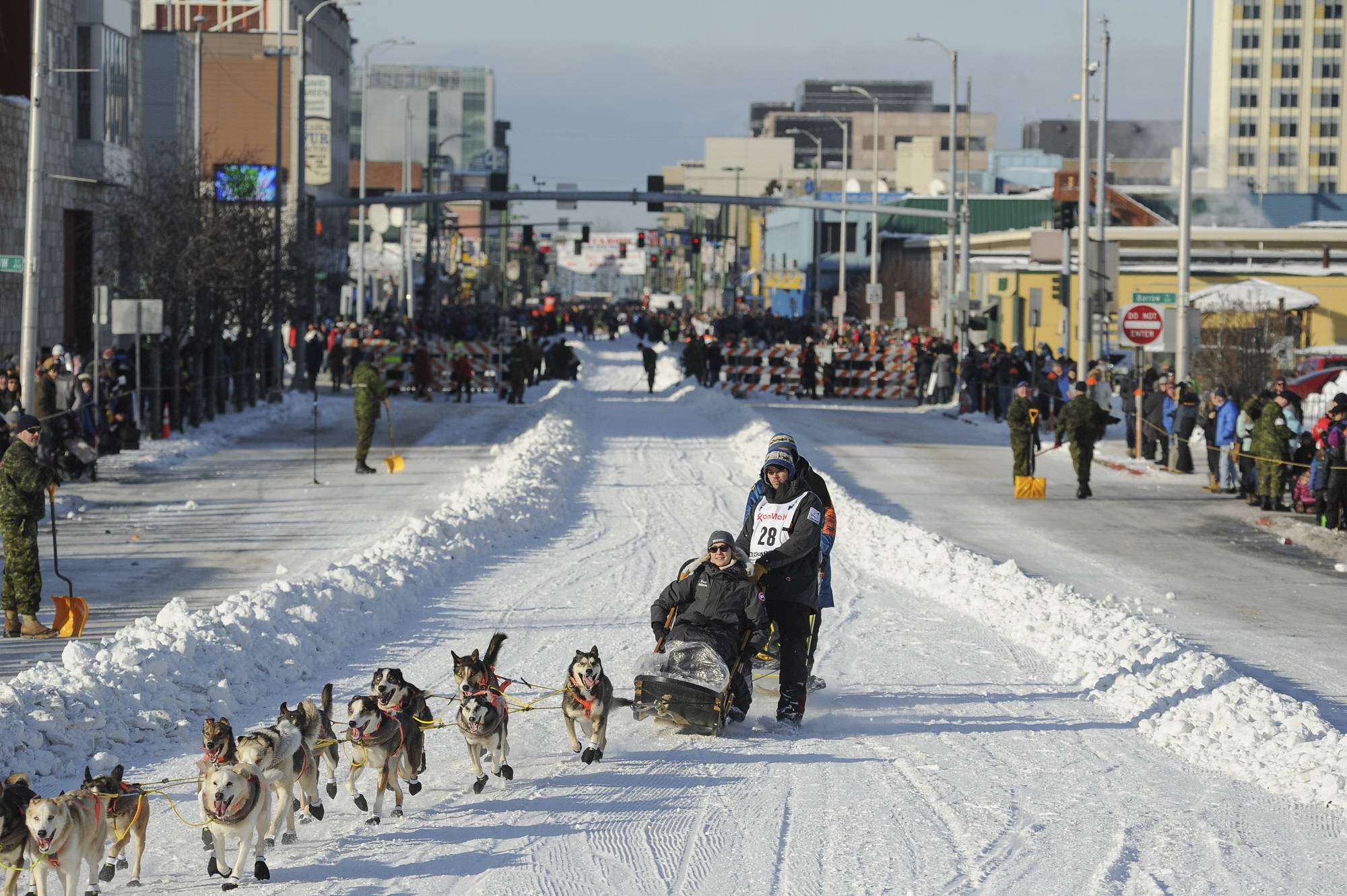 Defending champion Joar Lefseth Ulsom runs his team down Fourth Ave during the ceremonial start of the Iditarod Trail Sled Dog Race in Anchorage. Alaska Airlines announced Monday, March 2, 2020, it will drop its sponsorship of the Iditarod, Alaska's most famous sporting event. The airline in a statement said the decision was made as it transitions to a new corporate giving strategy, but People for the Ethical Treatment of Animals, the most vocal critic of the thousand-mile sled dog race across Alaska, immediately took credit. (AP Photo/Michael Dinneen, File)