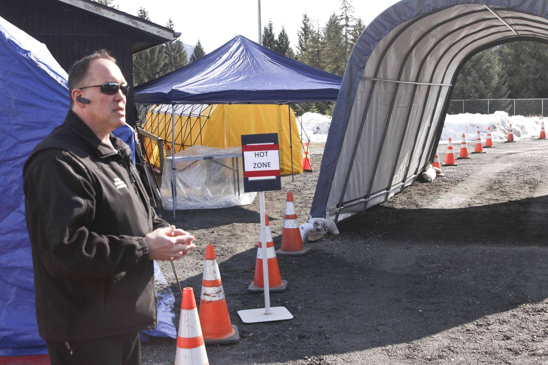 Michael S. Lockett | Juneau Empire                                  Capital City Fire/Rescue Community Community Assistance Response and Emergency Services manager Joe Mischler talks about the appointment-based drive-thru testing site located at the Hagevig Regional Fire Training Center for possible coronavirus victims on Tuesday.
