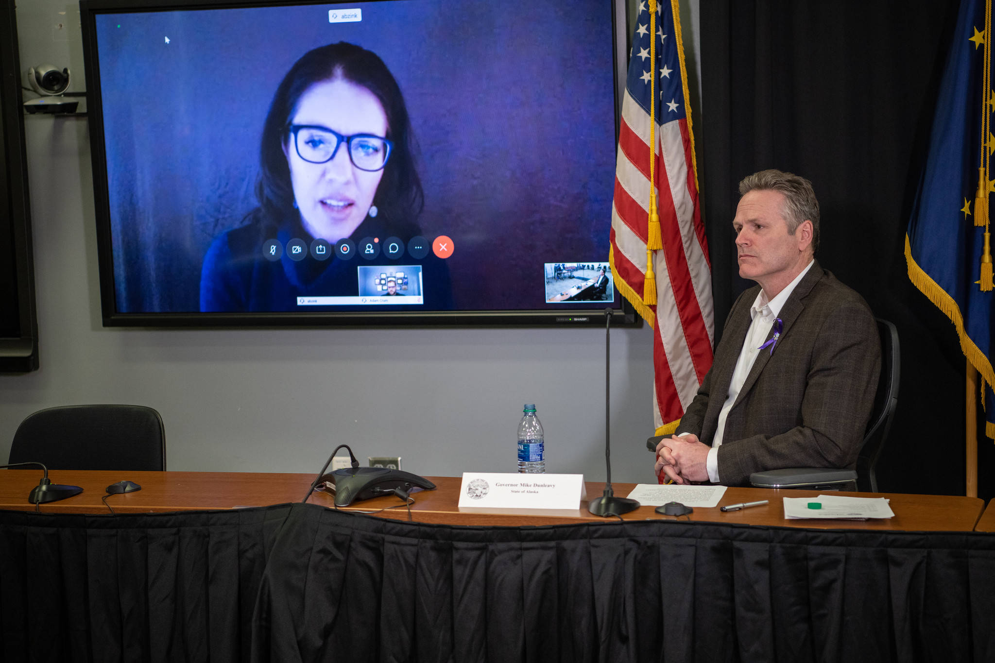 Gov. Mike Dunleavy at a press conference with Chief Medical Officer Dr. Anne Zink on Friday, March 27, 2020. (Courtesy photo | Office of Gov. Mike Dunleavy)