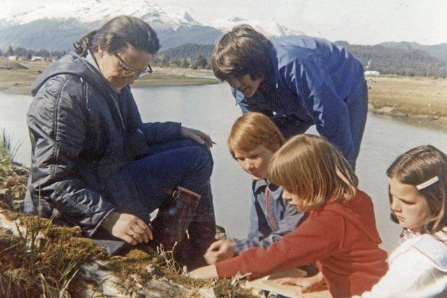 Mary Lou King shows children an example of Juneau's ecosystem as part of Sea Week, now celebrating its 50th anniversary in the Juneau School District. (Courtesy Photo | Peggy Cowan)