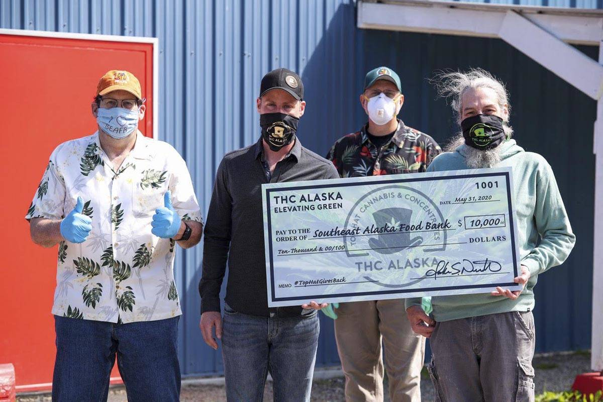 Members of Top Hat Cannabis pose with members of the Southeast Alaska Food Bank as they make a $10,000 donation to the food bank on Friday, May 29, 2020. (Courtesy photo | John Nemeth)