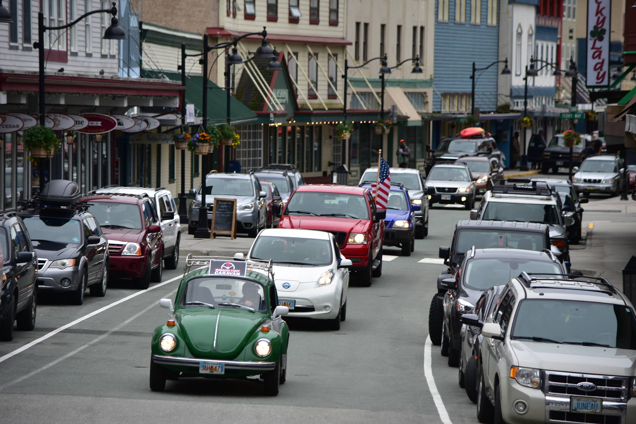 A caravan of union workers and their supporters drive through downtown Juneau on Wednesday, June 17, 2020, as part of a nation protest in support of workers during the COVID-19 pandemic. (Peter Segall | Juneau Empire)