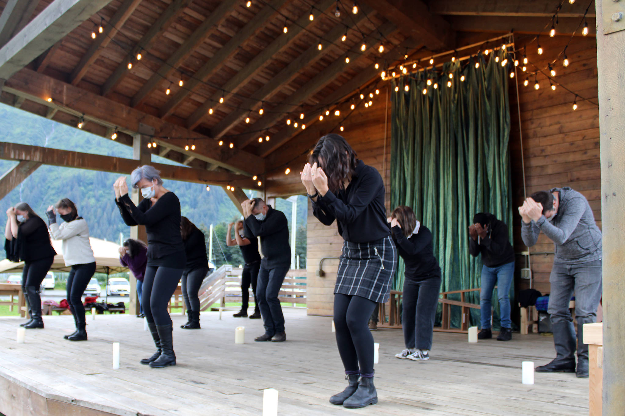 """The cast of Theatre in the Rough's production of """"As You Like It"""" rehearses the opening of the play. The sequence incorporating candles memorializes lives lost to COVID-19, lives lost to violence and is a show of solidarity with the Black Lives Matter movement."""