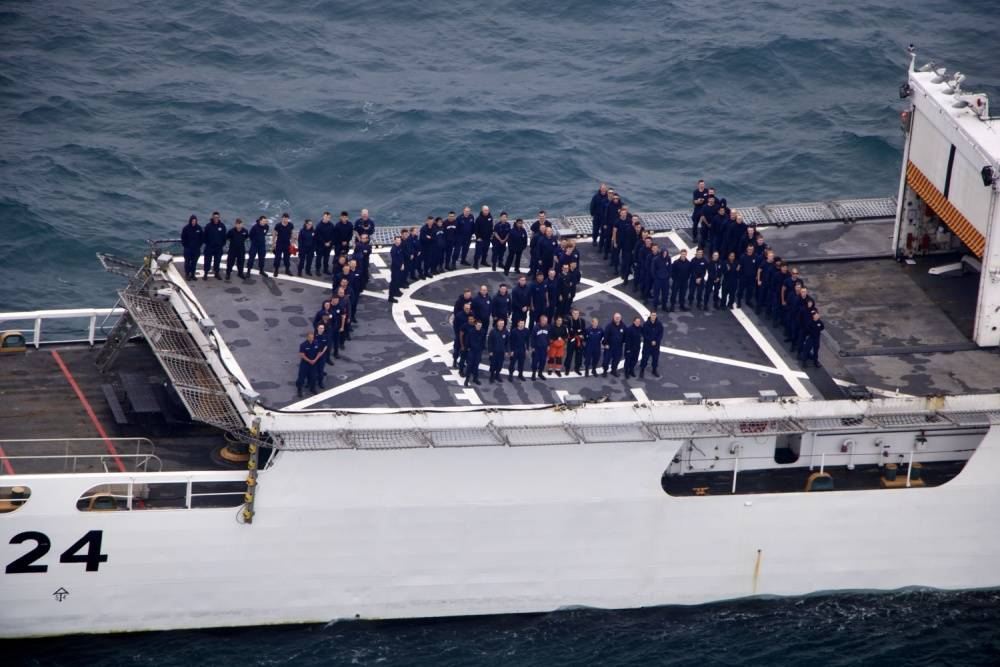 Members from Coast Guard Cutter Douglas Munro stand in formation on the back of the cutter, July 24, 2020. The cutter's hull day, July 24, correlates with its hull number, 724. (Courtesy photo / U.S. Coast Guard)