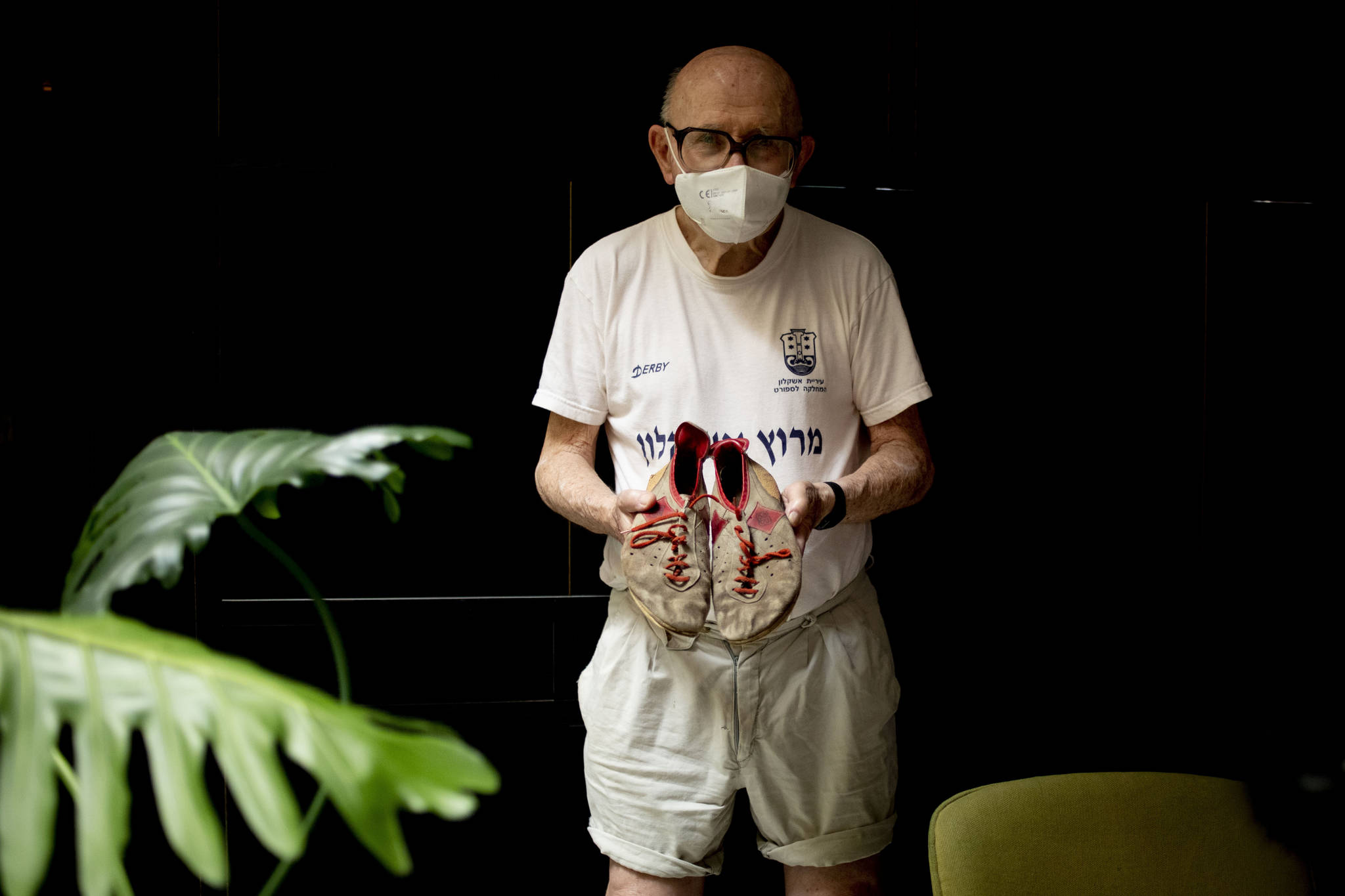 "Israeli Olympic racewalker Shaul Ladany holds his 1972's Olympic race shoes for a portrait in Omer, Israel, Sunday, July 12, 2020. In an instant, the world record holder in the 50-mile walk was thrust into one of sports' greatest tragedies and a seminal moment in modern history _ the kidnapping and massacre of his fellow Israeli team members at the 1972 Munich Olympics. The killing shocked the world, gave the Palestinian cause an audience and ushered in a new era of global terrorism. Ladany, a Holocaust survivor, the lessons still linger. He says it taught him to ""never be afraid"" but become ""more careful.""(AP Photo / Ariel Schalit)"