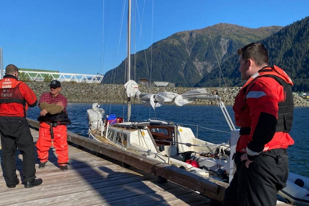 Several Coast Guard Station Juneau 45-foot Response Boat-Medium crew members speak with the owner of a disabled 22-foot sailing vessel after towing it from Marmion Island to Mike Pusich Douglas Harbor in Juneau, Sept. 13, 2020. (Courtesy Photo/Petty Officer 2nd Class Anthony DeLorenzo)