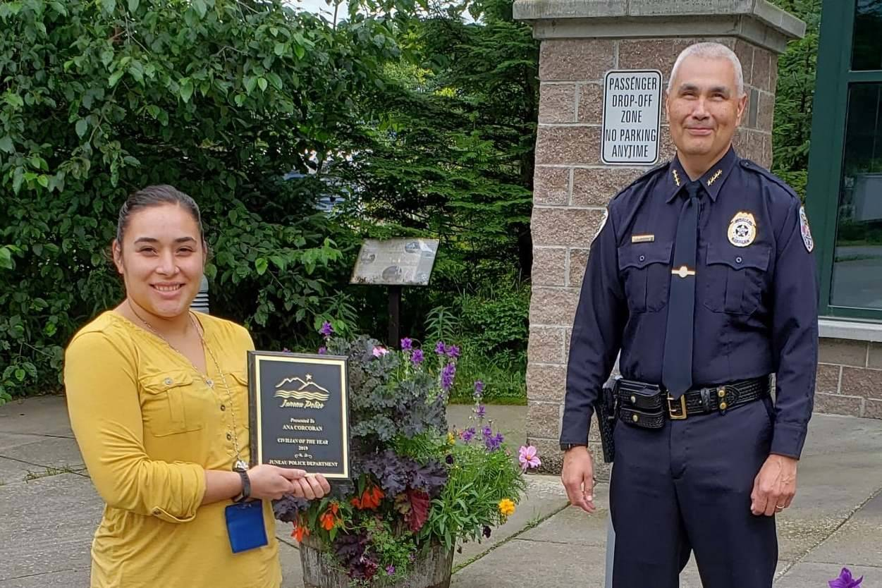 Ana Corcoran, left, receives a plaque from Juneau Police Department Chief Ed Mercer naming her his choice for JPD's Civilian of the Year, Sept. 18, 2020. (Courtesy Photo / Juneau Police Department)