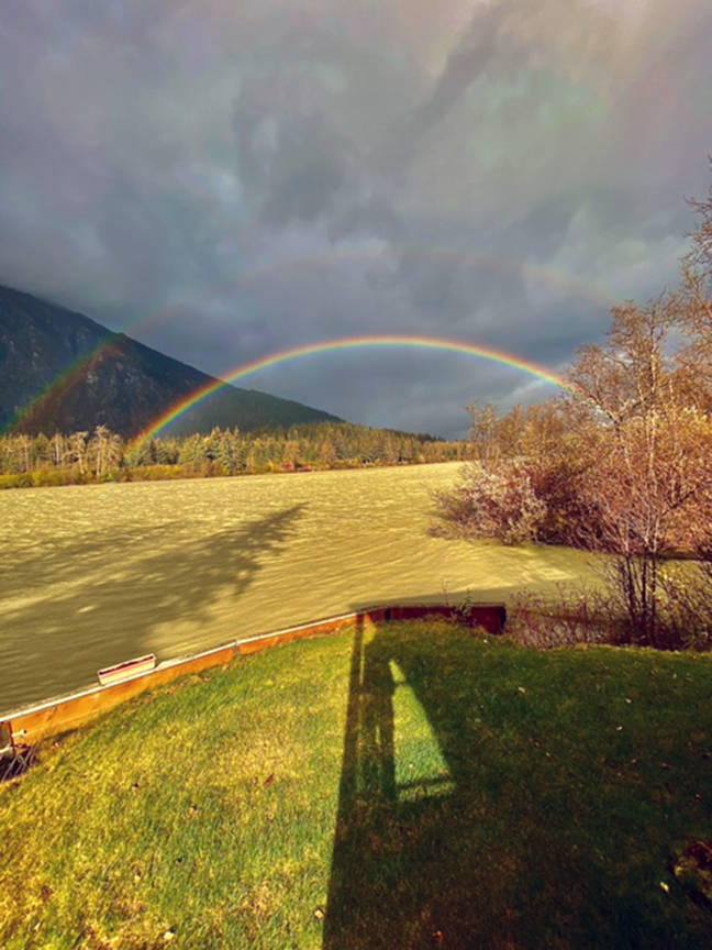 """A double rainbow is seen on the Taku River on Oct. 5. """"The river was running high and muddy after days and days of heavy rainfall,"""" writes Errol Champion. """"On that Monday afternoon there were sun breaks coupled with strong gusty winds that presented this view from my cabin which about three miles below the border with Canada."""" (Courtesy Photo / Errol Champion)"""
