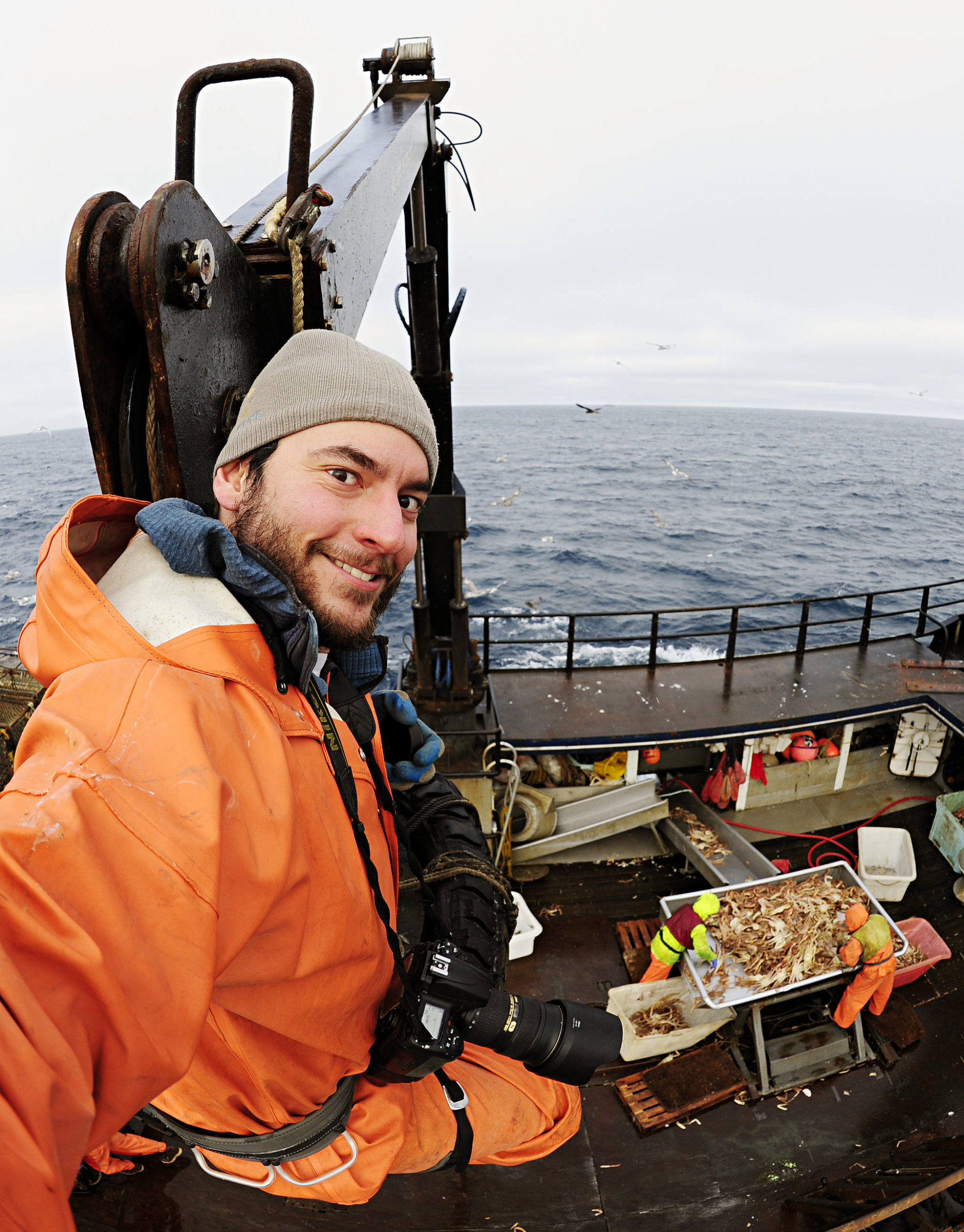 Chris Miller photographing the Bering Sea crab fishery. (Courtesy Photo / Chris Miller)