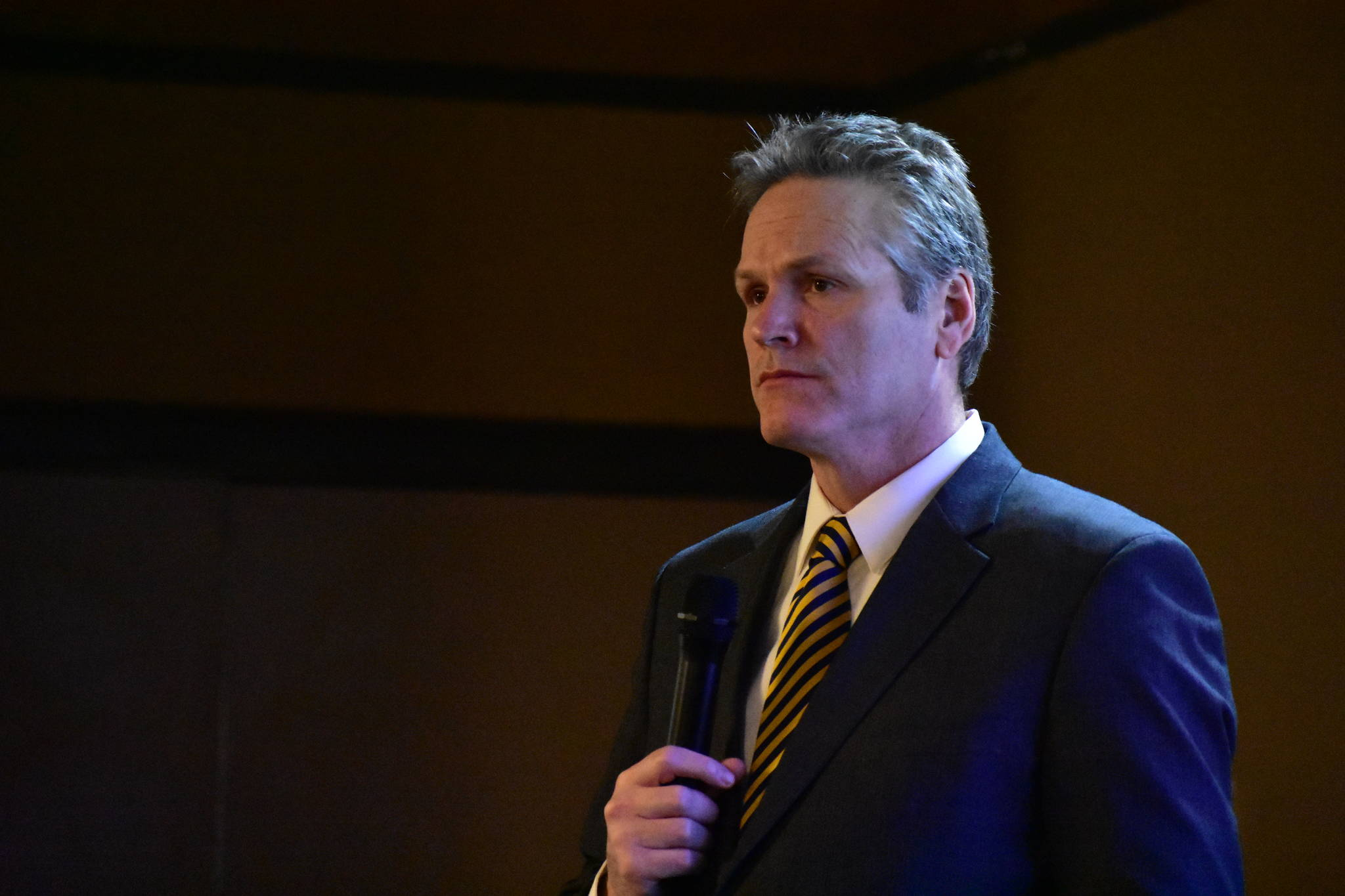 Gov. Mike Dunleavy speaks to local leaders at the Alaska Municipal League's legislative conference in this February 2020 photo. (Peter Segall/  Juneau Empire File)