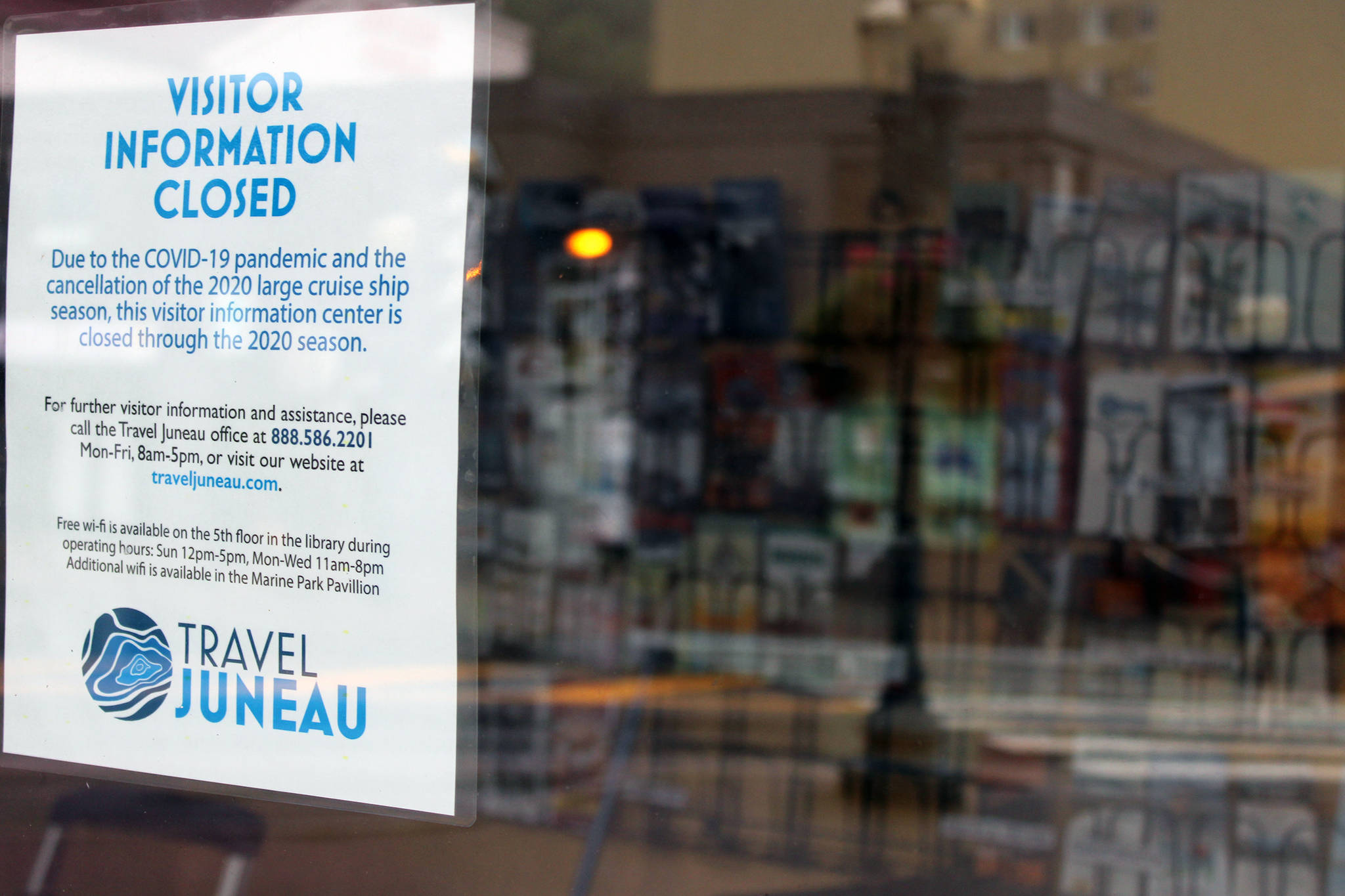A sign posted by Travel Juneau notes the pamphlet-filled visitor's center kiosk is closed because of the pandemic. The center, located near the downtown library, opened in May 2019 during Infrastructure Week. (Ben Hohenstatt / Juneau Empire)