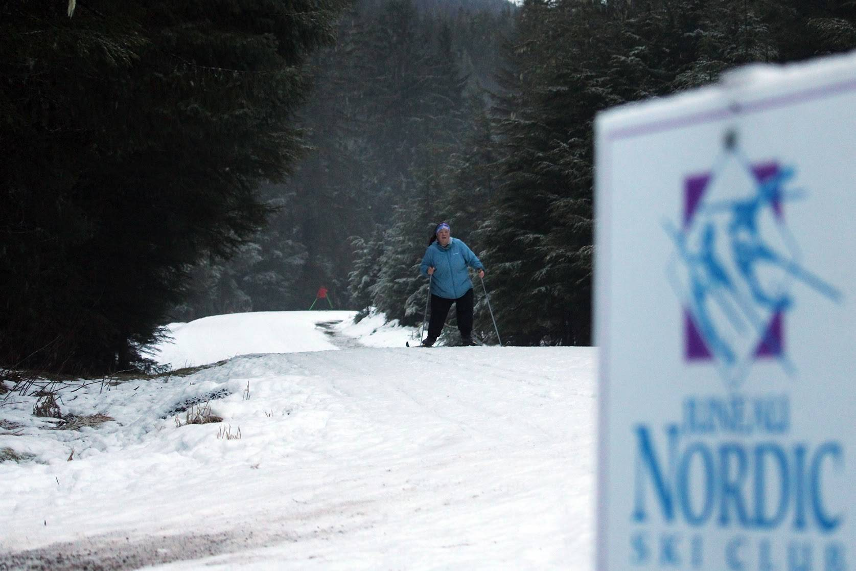 Allison Smith, a member of the Juneau Nordic Ski Club, passes another skier on her way along Montana Creek Road. Ski trails around Juneau will soon be hiding clues for Juneau Nordic Ski Club's ski-o'cache event. (Ben Hohenstatt/Juneau Empire)