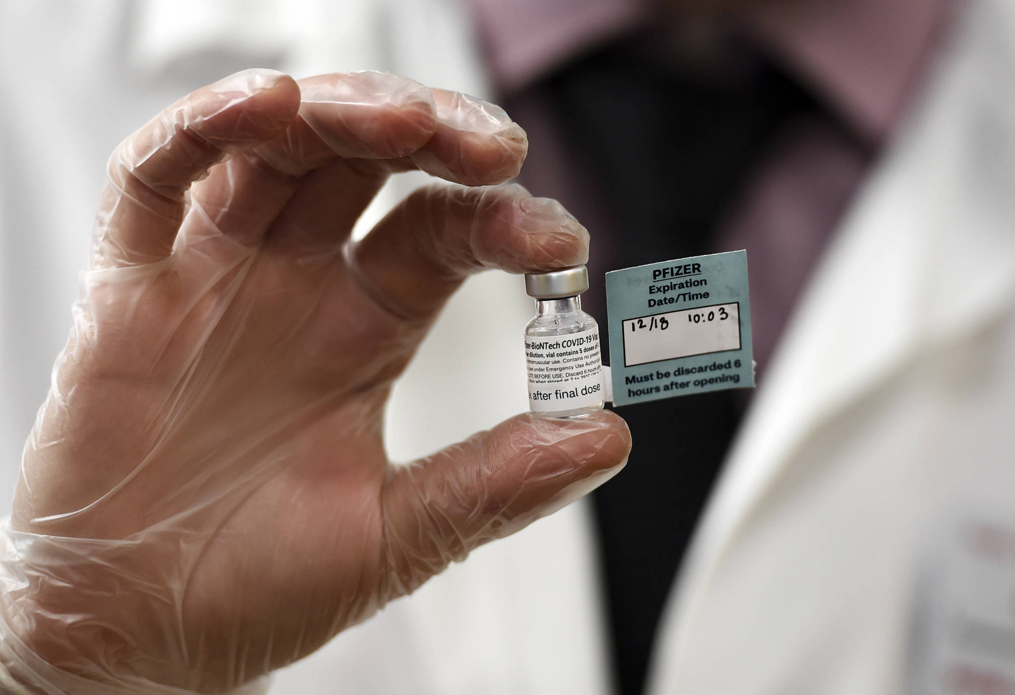 A vial of the Pfizer vaccine used at The Reservoir nursing facility, is shown, Friday, Dec. 18, 2020, in West Hartford, Conn. (AP Photo / Stephen Dunn,Pool)