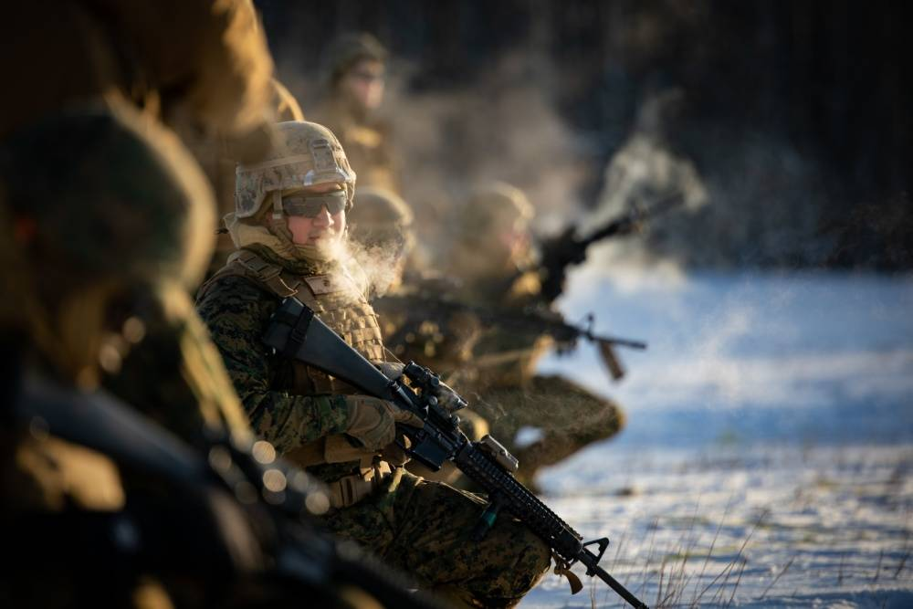 Cpl. Jose M. Barragan, a bulk fuel specialist with 7th Engineer Support Battalion, 1st Marine Logistics Group, prepares to conduct a live-fire and maneuver range in Fort Greely, Alaska, Feb. 11, 2020, prior to exercise Arctic Edge 20. (U.S. Marine Corps / Lance Cpl. Christopher W. England)