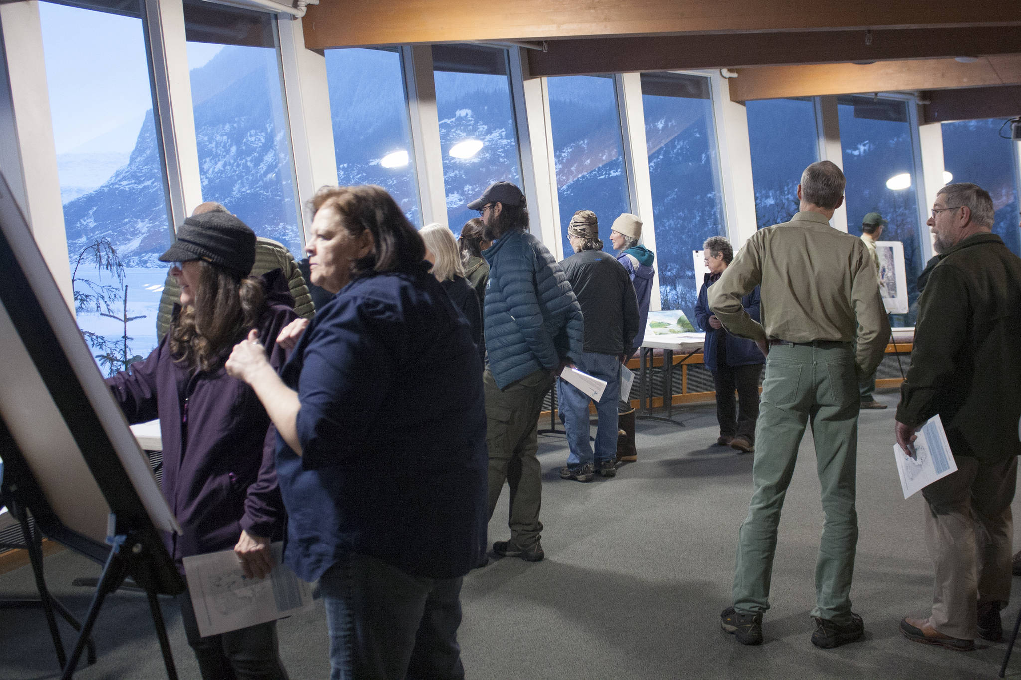 Despite howling winds and plenty of slush, dozens of people attended a scoping open house in February 2020 at the Mendenhall Glacier Visitor Center. (Ben Hohenstatt / Juneau Empire File)