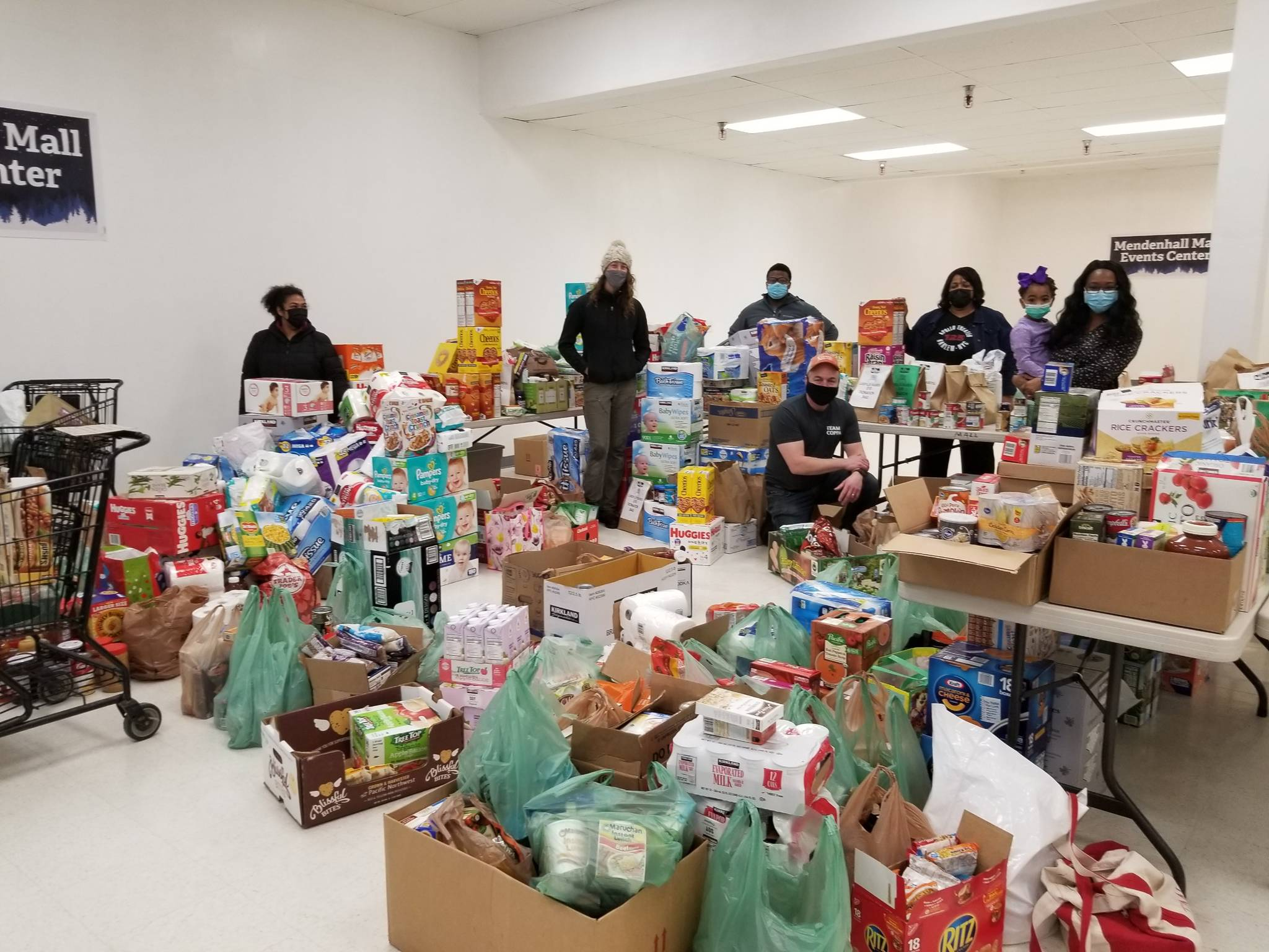 Members of the Black Awareness Association of Juneau and other volunteers collect donations from Juneau residents from their Martin Luther King Jr. Day donation drive on Jan. 18, 2021. (Courtesy photo / Black Awareness Association of Juneau)