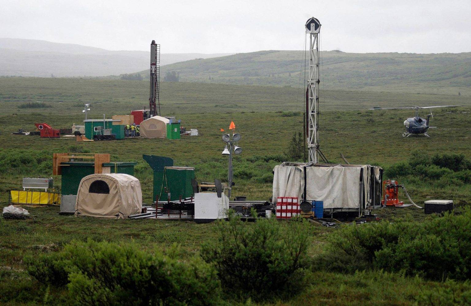 In this July 13, 2007, file photo, workers with the Pebble Mine project test drill in the Bristol Bay region of Alaska, near the village of Iliamma. (AP Photo / Al Grillo)
