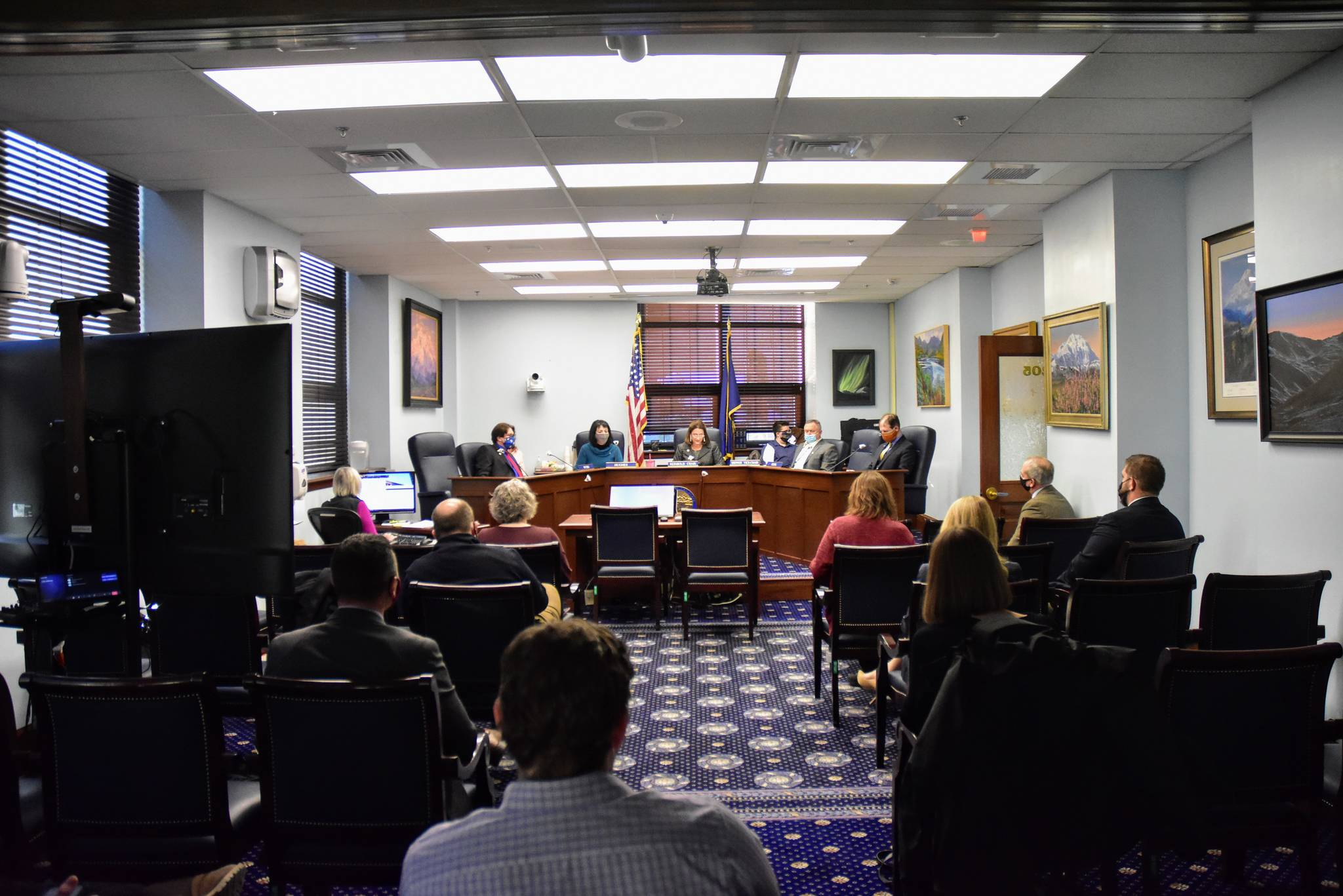 Staff, lawmakers and members of the press gather for the first Senate Judiciary Committee meeting of the 32nd Legislature on Wednesday, Jan. 27, 2021. While Senators moved ahead with work, the House of Representatives was once again unable to organize. (Peter Segall/Juneau Empire)