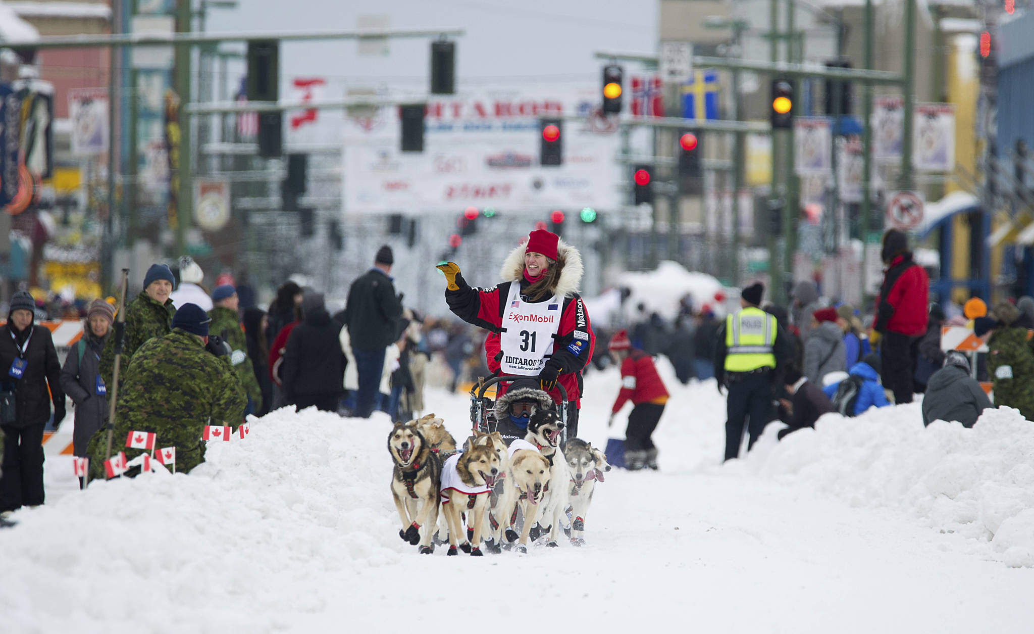 In this March 2018 photo,  Aliy Zirkle runs her team during the ceremonial start of the Iditarod Trail Sled Dog Race in Anchorage, Alaska. There has been another dramatic change to the world's most famous sled dog race this year because of the pandemic, with officials announcing Friday, Feb. 5, 2021, that the ceremonial start has been canceled. (AP Photo / Michael Dinneen)