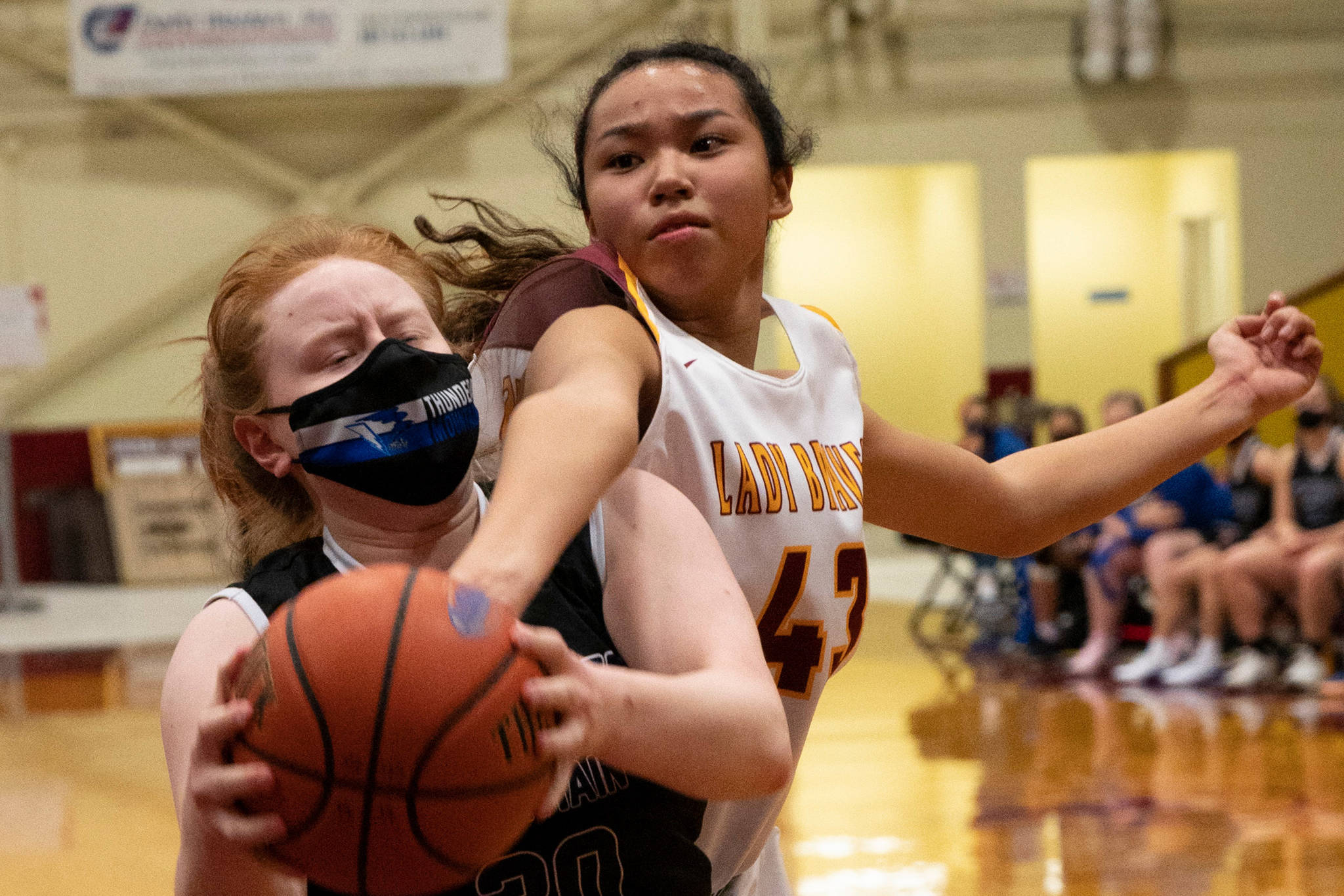 Thunder Mountain High School player Mackenzie Gray, left, competes with Mt. Edgecumbe High Schoool in Sitka on Saturday, Feb. 6, 2021. (Sitka Sentinel / James Poulson)