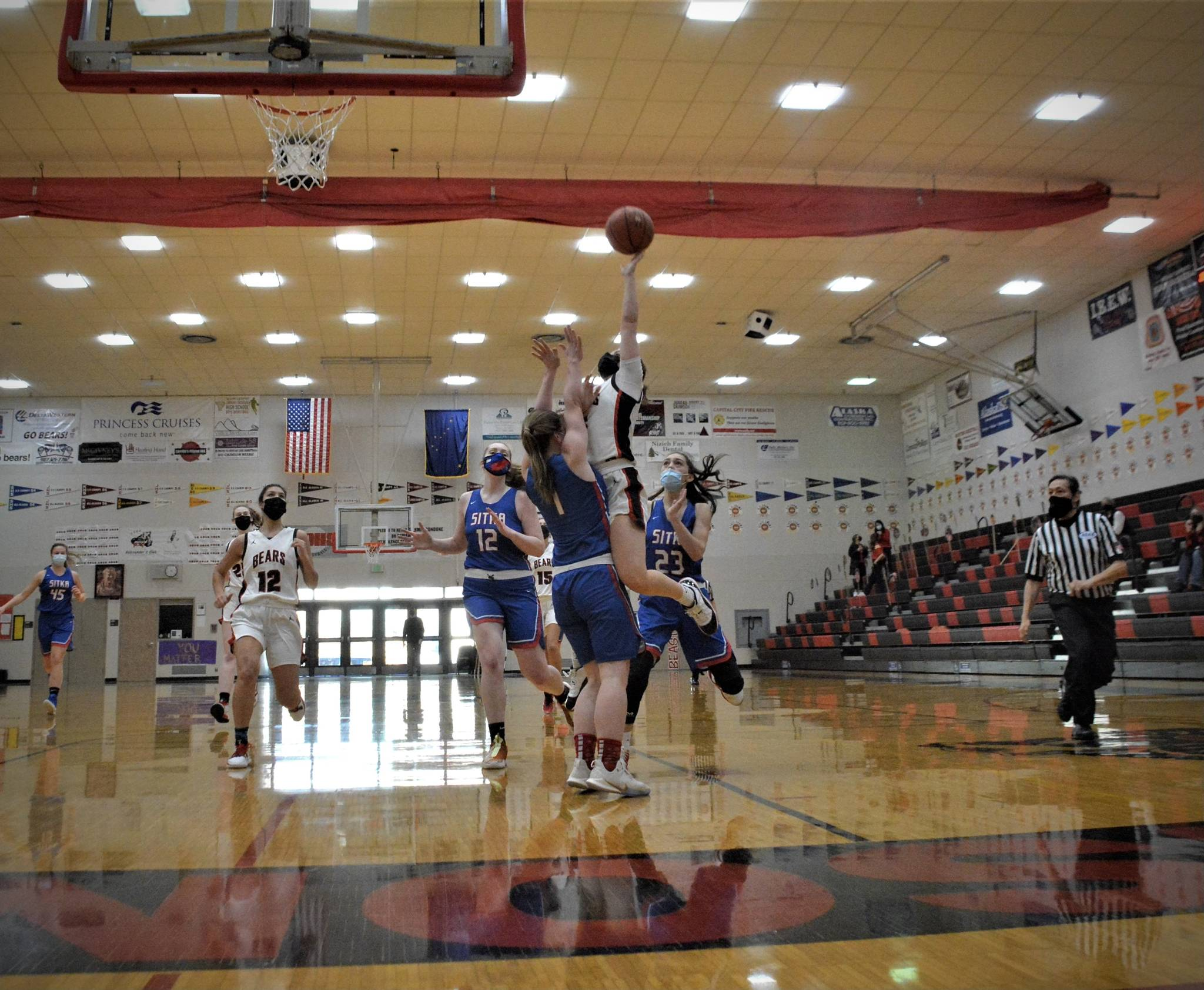The Juneau-Douglas High School Yadaa.at Kalé girls basketball team compete with the Sitka High School on Saturday, Feb. 13, 2021. (Courtesy photo / Kim Andree)