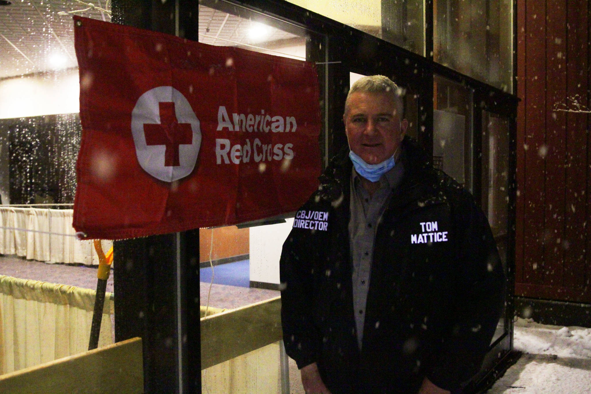 City and Borough of Juneau emergency program manager Tom Mattice stands outside Centennial Hall, appropriated as an evacuation shelter for those in the path of possible avalanches on Feb. 27, 2021. (Michael S. Lockett / Juneau Empire)