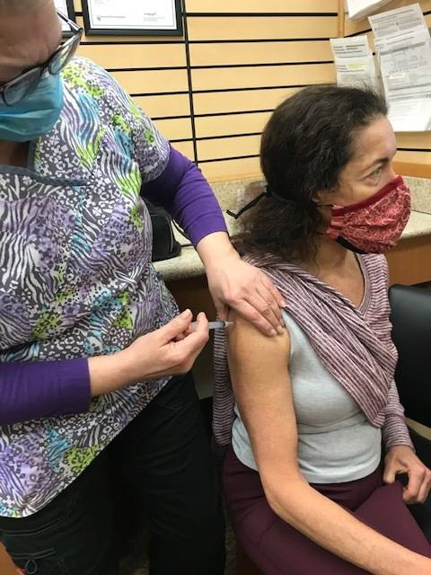 """""""I'll tell you, one reason I got the COVID vaccines is because wearing a mask is getting old, and I want to do my part in helping us get past necessary mask mandates,"""" writes Dr. Emily Kane. (Courtesy Photo)"""