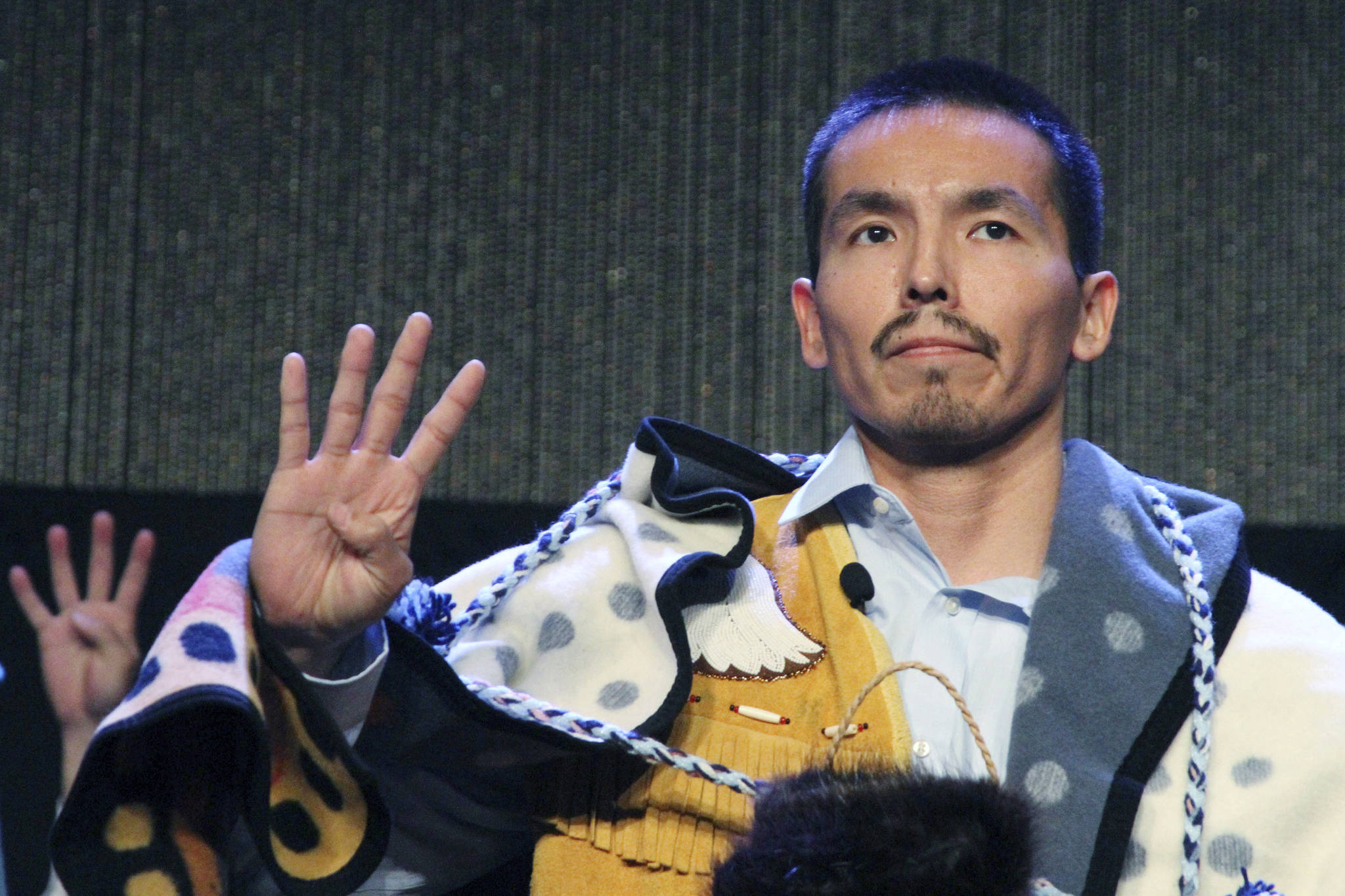 """Marvin Roberts flashes four fingers in a sign of solidarity for the so-called Fairbanks Four following his address at the Alaska Federation of Natives conference in Anchorage in this 2017 photo. Roberts and three other men were convicted of killing a Fairbanks teenager in 1997. Four men who say they were illegally imprisoned for nearly two decades for the murder of a teenager in Alaska will have their lawsuit go forward after the U.S. Supreme Court declined to get involved in the case. The high court turned away the case Monday. As is typical, the justices did not comment in rejecting the case. That leaves in place a decision by the 9th U.S. Circuit Court of Appeals. In January of last year it overturned a lower court ruling that had dismissed a lawsuit by the """"Fairbanks Four"""" against the city of Fairbanks. (AP Photo / Mark Thiessen)"""