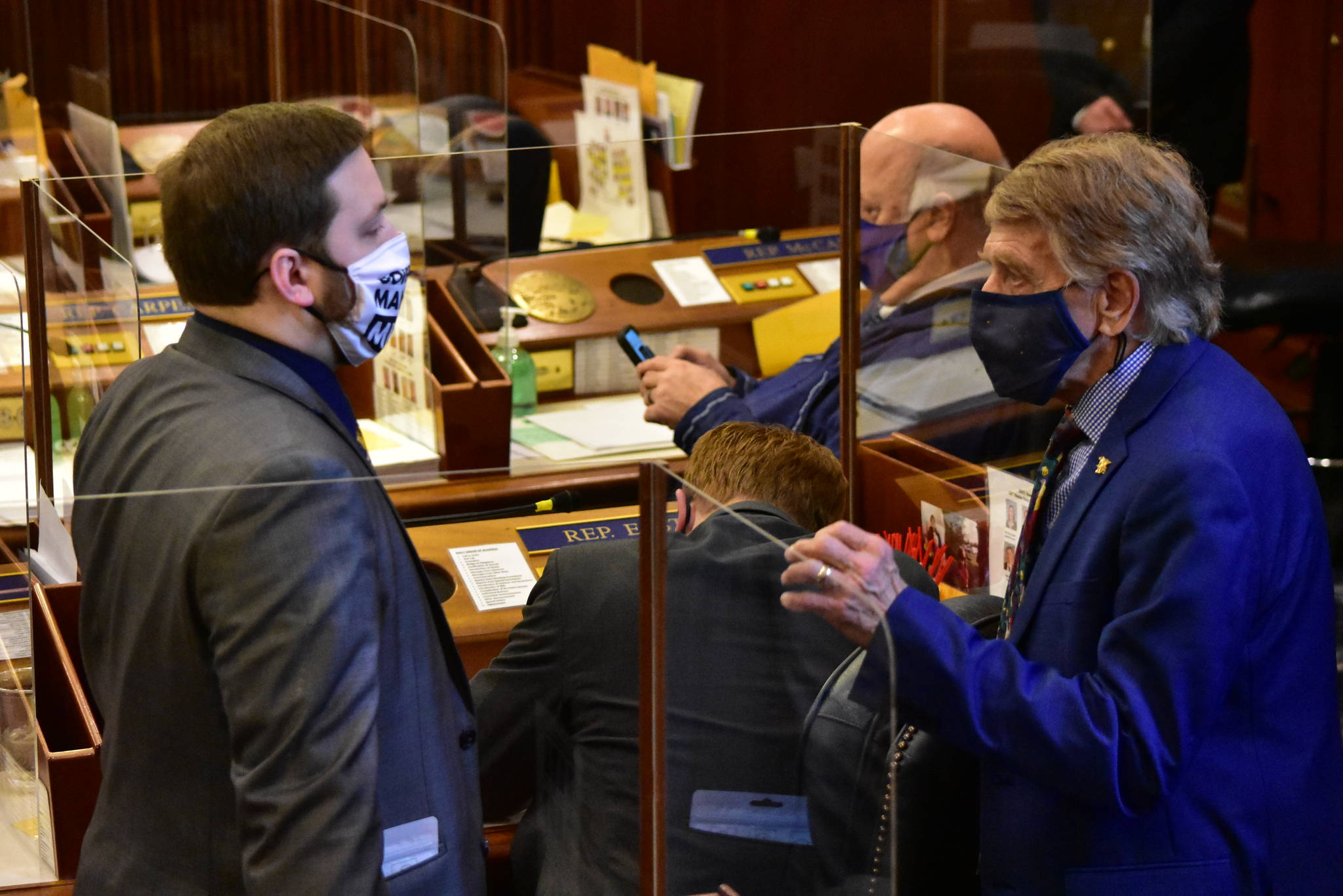 House Minority Whip Rep. Laddie Shaw, R-Anchorage, speaks to Rep. Chris Kurka, R-Wasilla on Friday, March 19, 2021. (Peter Segall / Juneau Empire)