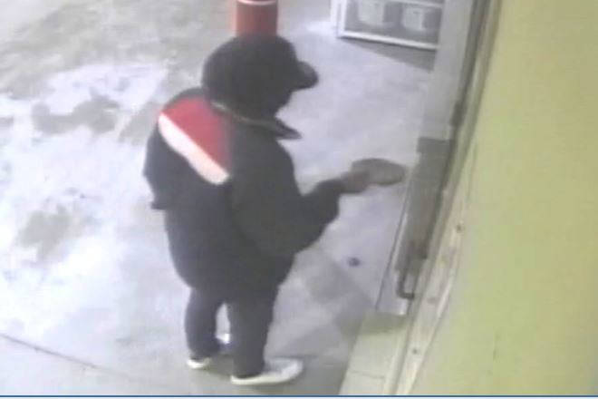 The Juneau Police Department are seeking a man, seen here in security footage, involved in the robbery of the Safeway fueling station early Sunday morning.