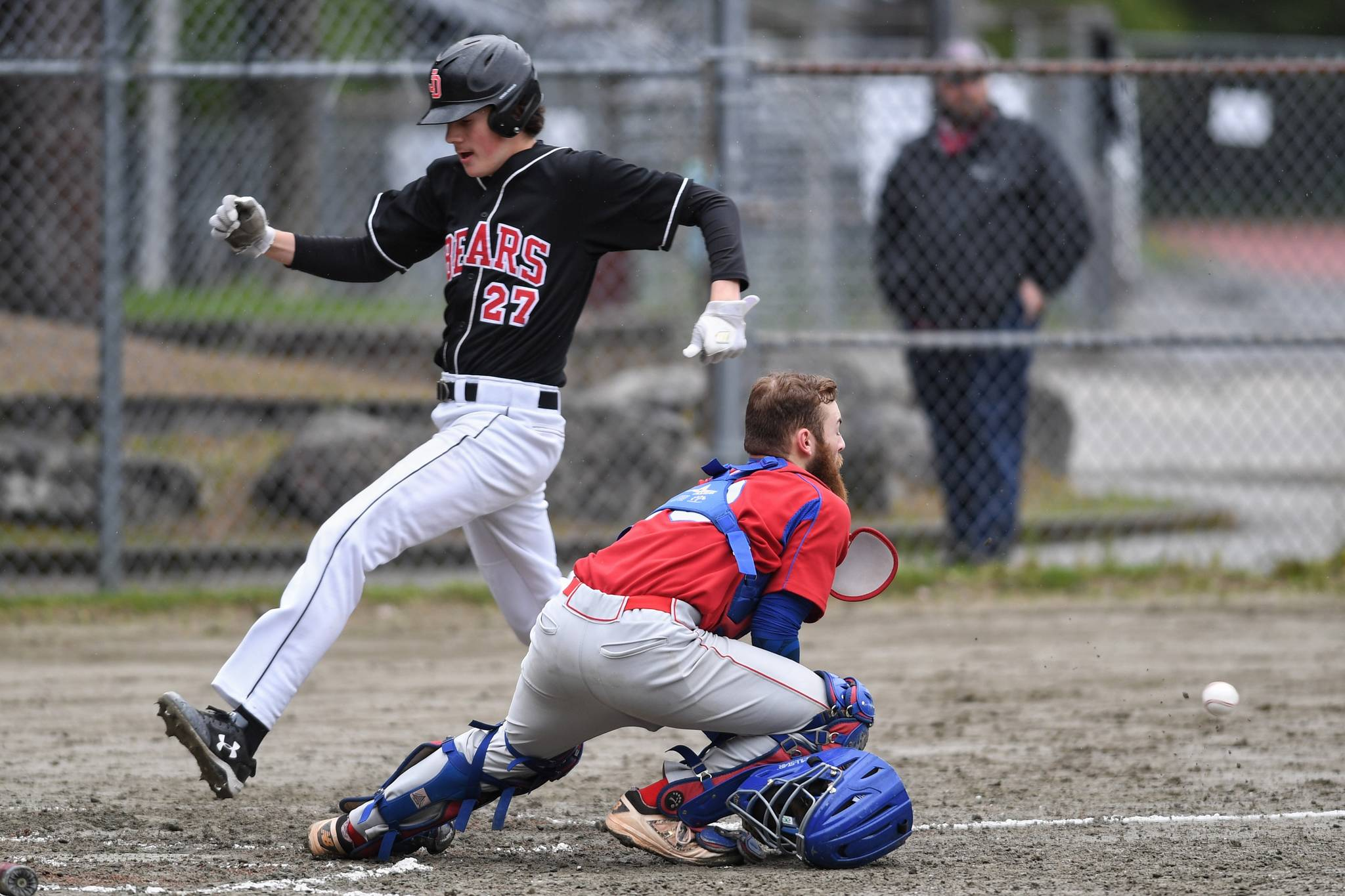 Juneau-Douglas' Garrett Bryant scores in front of the throw to Sitka's catcher Morgan Simic in the fourth inning during the Region V Baseball Championship at Adair-Kennedy Memorial Park on Thursday, May 23, 2019. Bryant and the Crimson Bears will play games in Sitka Friday and Saturday. (Michael Penn / Juneau Empire File)