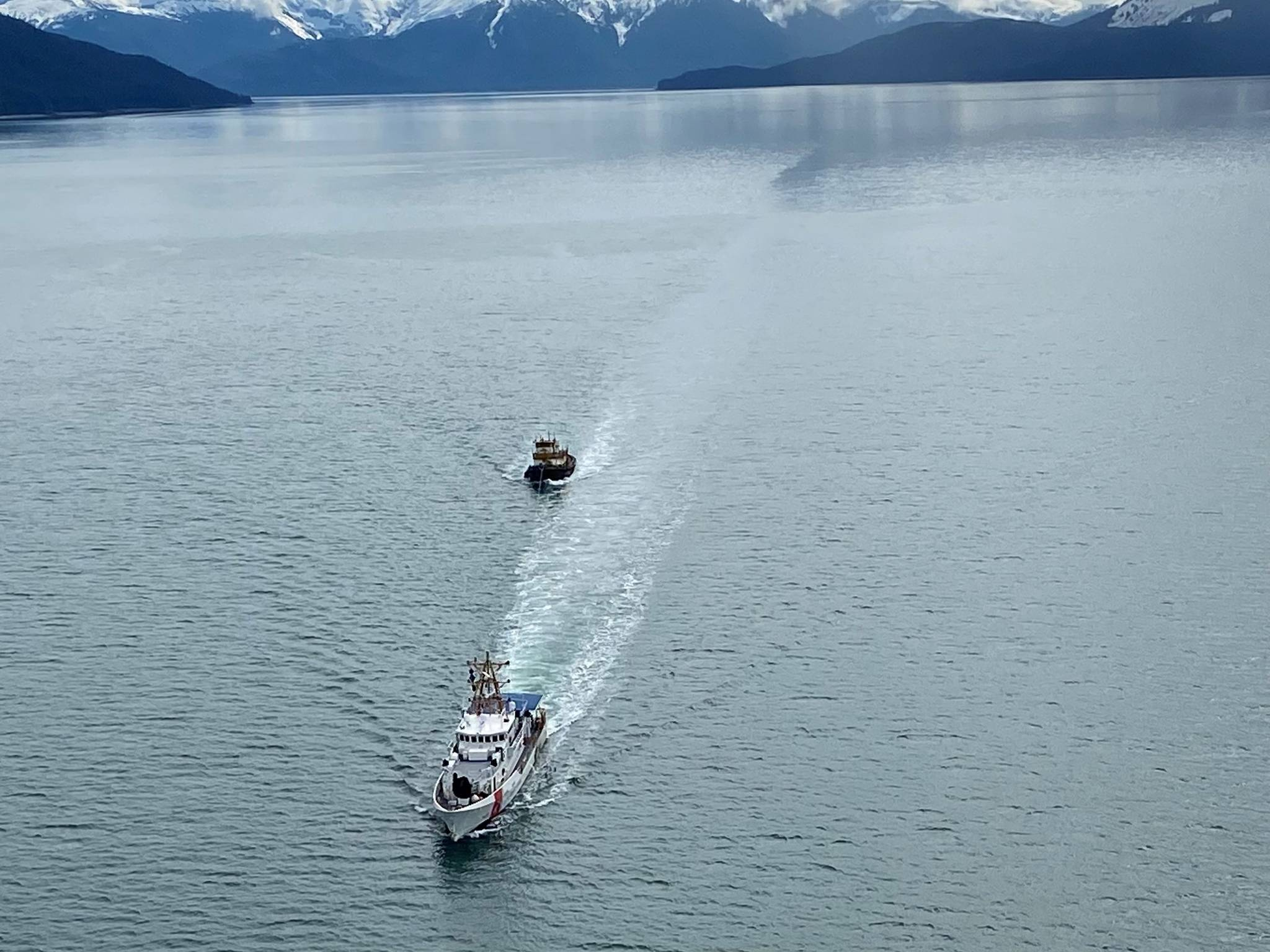 Coast Guard Cutter John McCormick, a 154-foot Sentinel–class vessel, towed the derelict tugboat Lumberman, to a position 54 miles west of Cross Sound, Alaska, on May 2, 2021. The decision to dispose of the Lumberman at sea, which had been abandoned in the Gastineau channel in 2016, was made after it was determined to be derelict and posed a significant public safety risk. (Courtesy photo / U.S. Coast Guard)