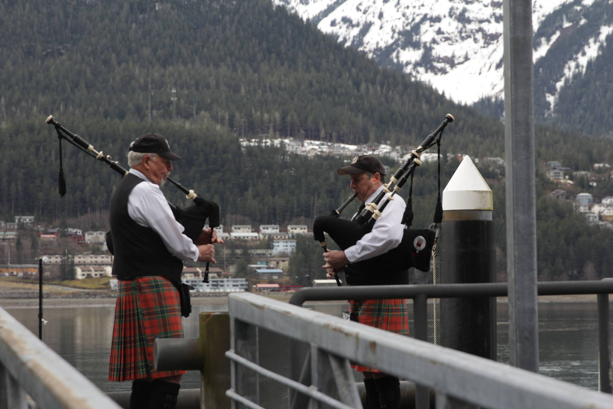 Members of the City of Juneau Pipe Band play their bagpipes during the 31st annual Blessing of the Fleet and Reading of Names at the Alaska Commercial Fishermen's Memorial in Juneau on May 1, 2021. (Michael S. Lockett / Juneau Empire)