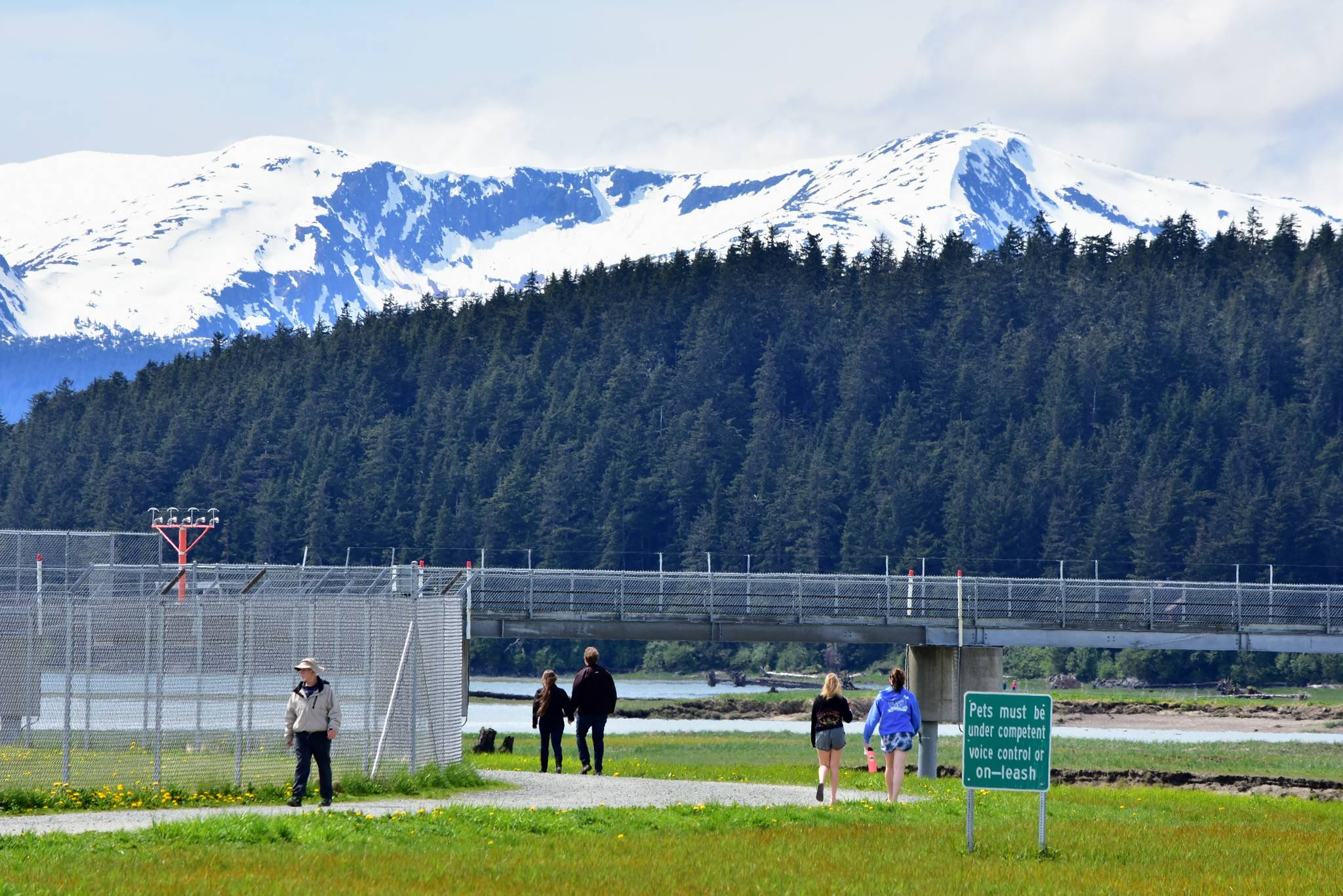 Juneauites walking the Airport Dike Trail, seen here on Tuesday, May 25, 2021, probably won't see the monitoring wells being installed in the area around the Juneau International Airport to test for contamination from  per- and polyfluoroalkyl substances, commonly known as PFAS chemicals. Ground water testing is set to take place over the next few years. (Peter Segall / Juneau Empire)
