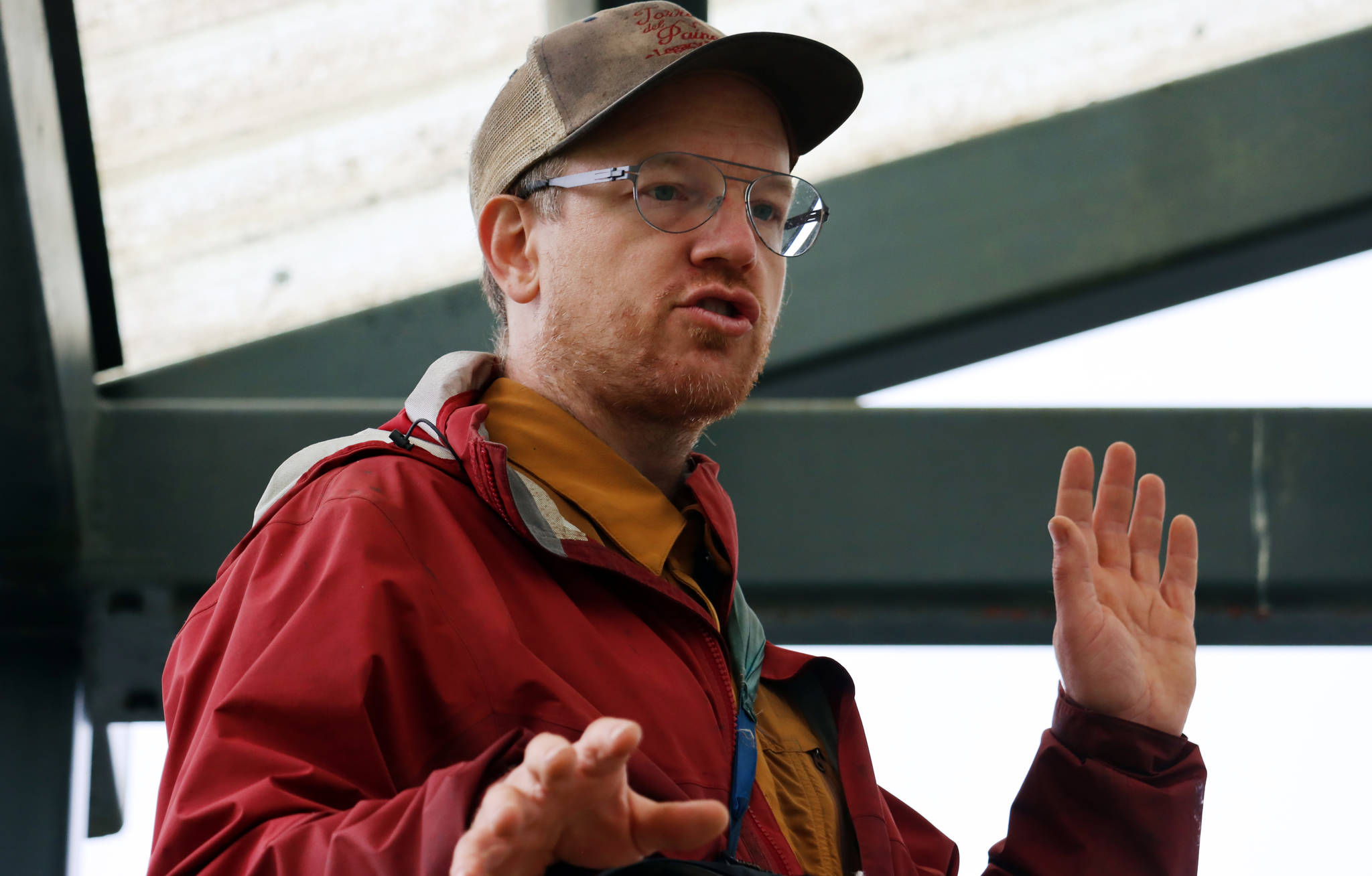 """Bretwood """"Hig"""" Higman, executive director of Ground Truth Trekking, talks Thursday at a news conference outside Dzantik'i Heeni Middle School about the risk of an eventual landslide in the Lemon Creek area. (Ben Hohenstatt / Juneau Empire)"""