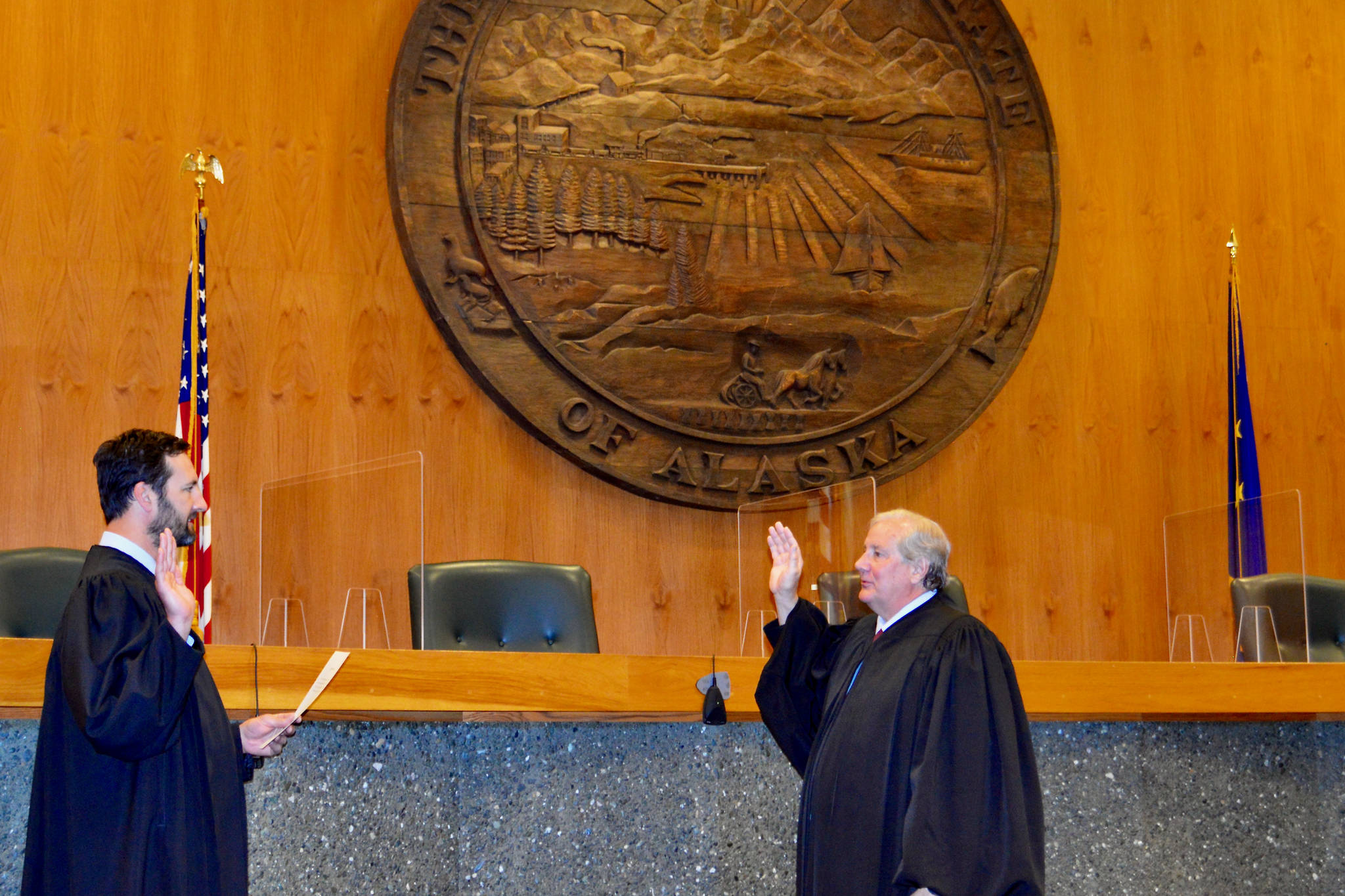 Courtesy photo / Alaska Court System  Chief Justice Daniel E. Winfree, right, is sword in by Justice Dario Borghesan in Anchorage on July 1. Winfree will take over after former Chief Justice Joel Bolger retired earlier this year.