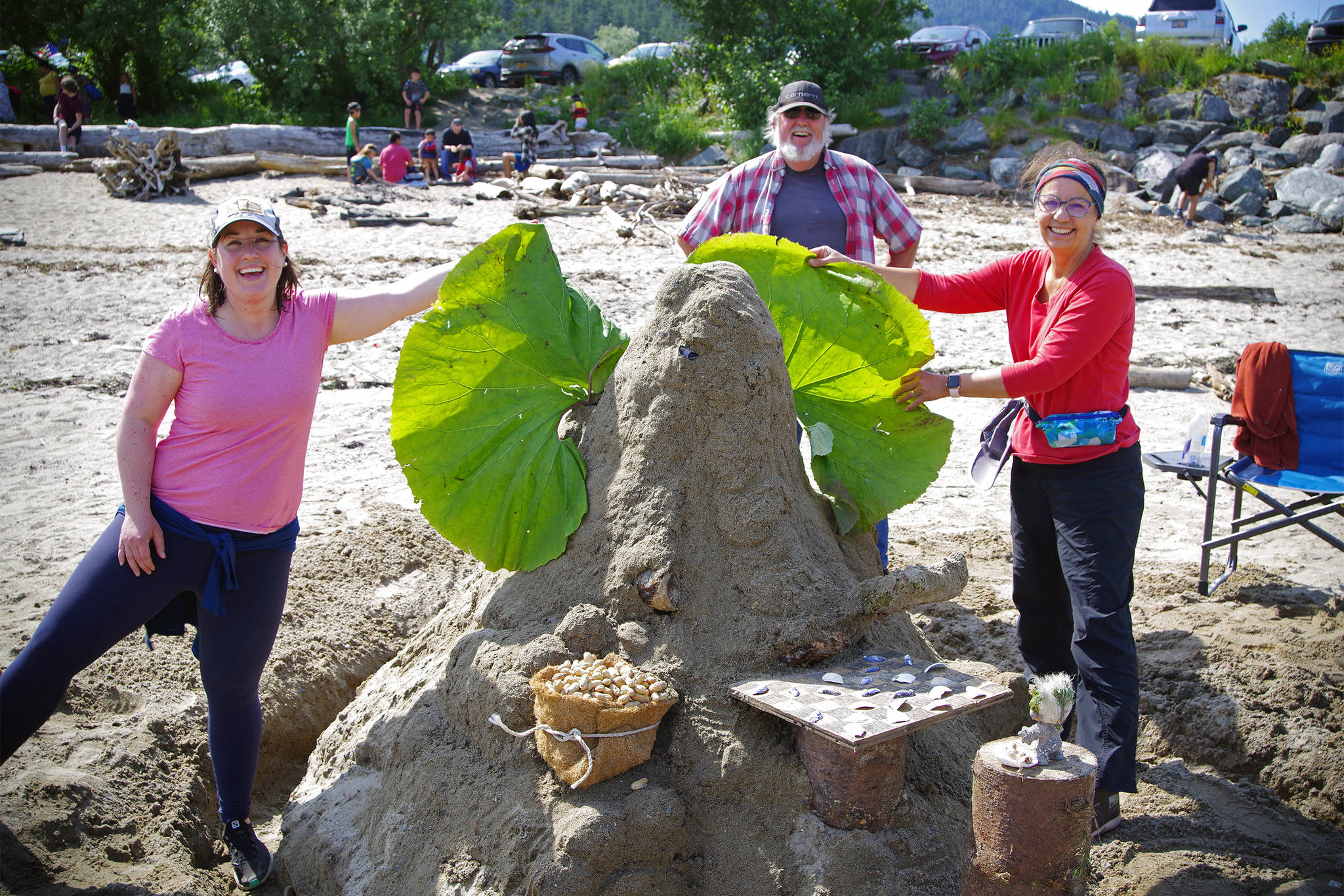 """Team Waldon Trolls shows off their sandcastle, """"Elephant Playing Checkers with a Troll,"""" which was awarded first place in the sandcastle competition sponsored by the Douglas Fourth of July committee on July 4, 2021. (Courtesy photo/Zane Jones)"""
