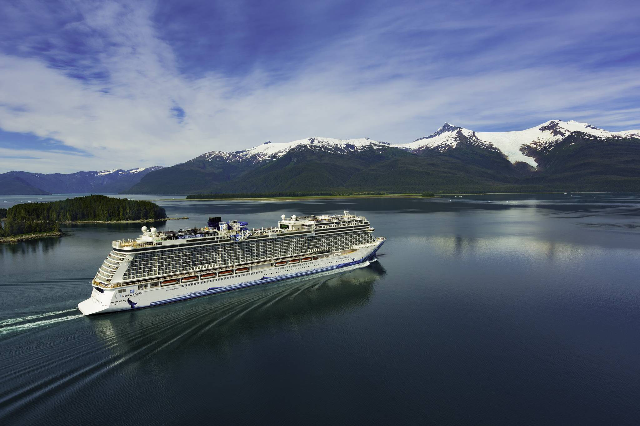 Large cruises ships like Norwegian Cruise Line's Norwegian Bliss, seen here near Ketchikan in this undated photo, are returning to Alaska after being shutdown due to COVID-19. Trade group Cruise Lines International Association says the industry is ready to get back to business safely. (Courtesy photo / Norwegian Cruise Line)