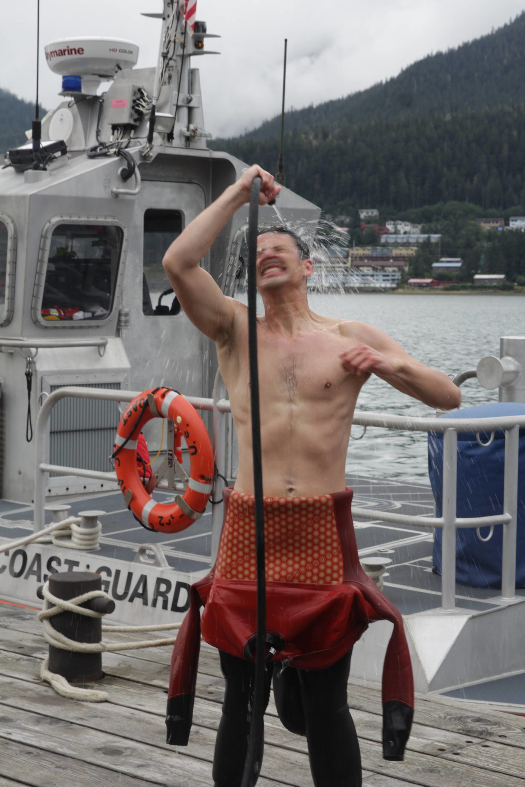 Army Pfc. Dylan Kloss rinses off after a dive in downtown Juneau as part of training for the engineer divers with a Coast Guard dive team on Sept. 6, 2021. (Courtesy photo / MyKenzie Robertson)